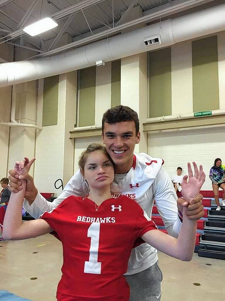Naperville Central quarterback Payton Thorne poses with junior Annie Miller.