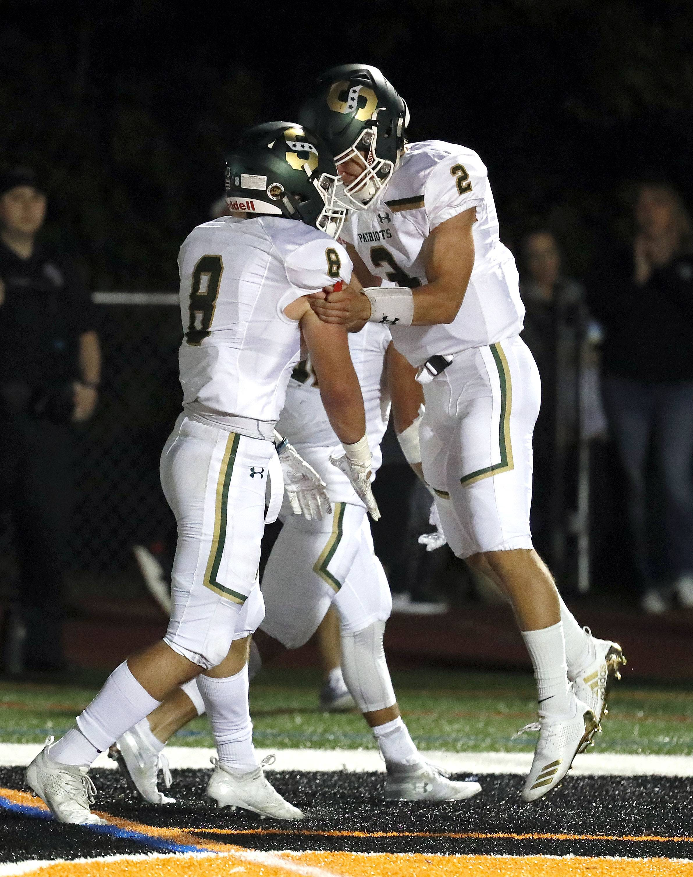 Stevenson's Cole Okmin (2) celebrates with Ryan McElhinny after his touchdown run during their game Friday night in Libertyville.