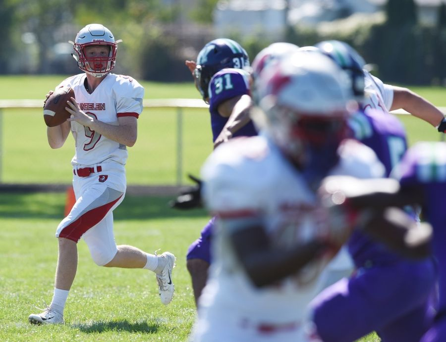 Mundelein quarterback Isaac Wellman looks to pass during Saturday's game at Weiss Field in Waukegan.