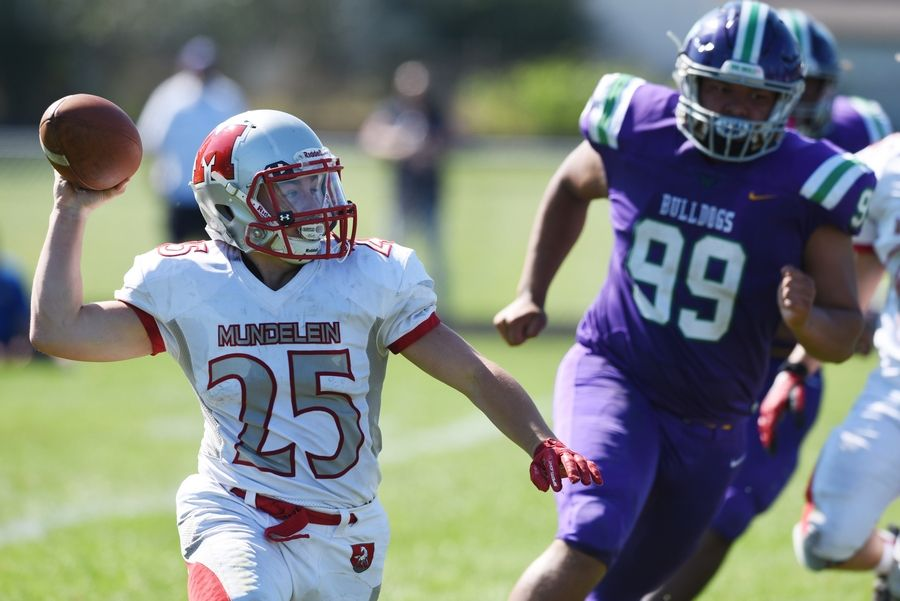 Mundelein's Shawn Patrick throws a pass for a completion during Saturday's game at Weiss Field in Waukegan.