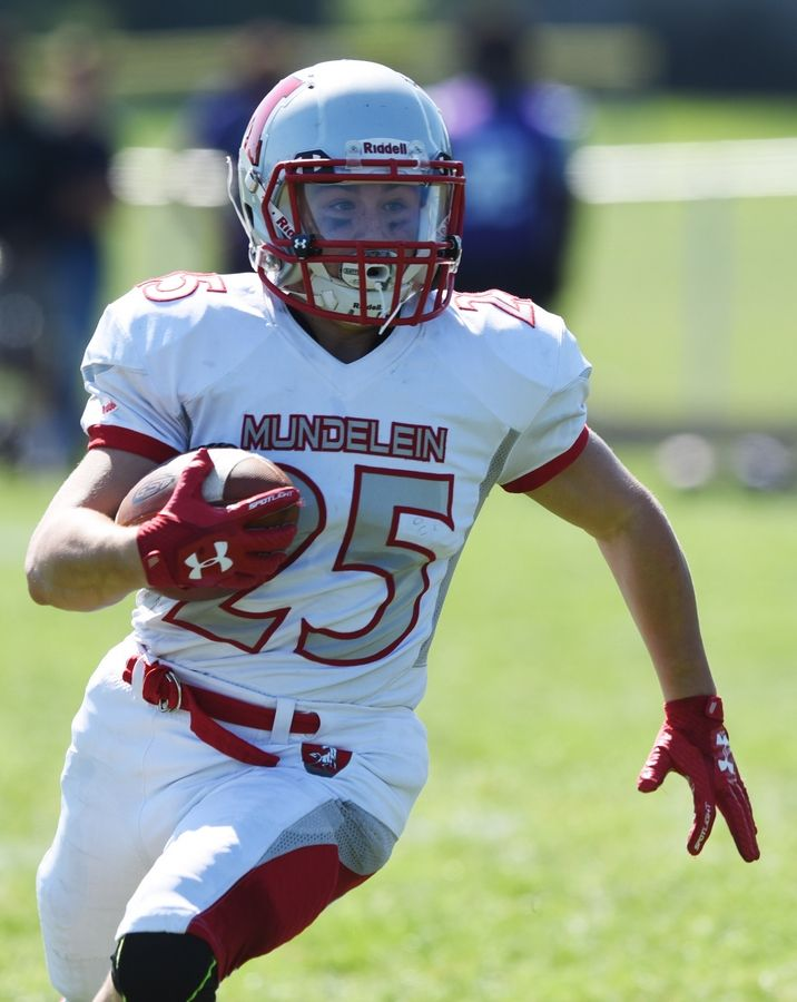 Mundelein's Shawn Patrick carries the ball during Saturday's game at Weiss Field in Waukegan.