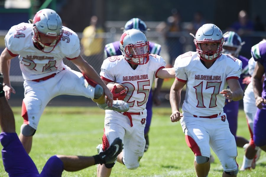 Mundelein's Shawn Patrick (25) carries the ball for a touchdown during Saturday's game at Weiss Field in Waukegan.