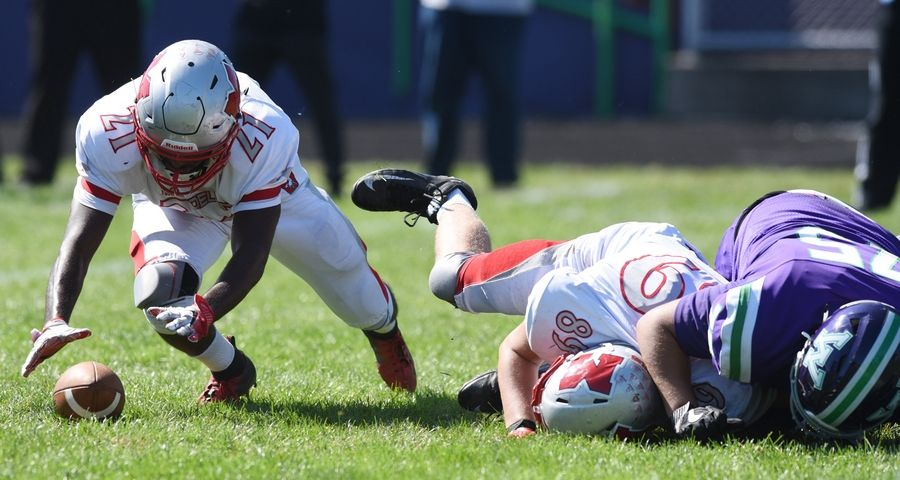 Mundelein's Tabor Alemu tries to grab a Waukegan fumble during Saturday's game at Weiss Field in Waukegan.