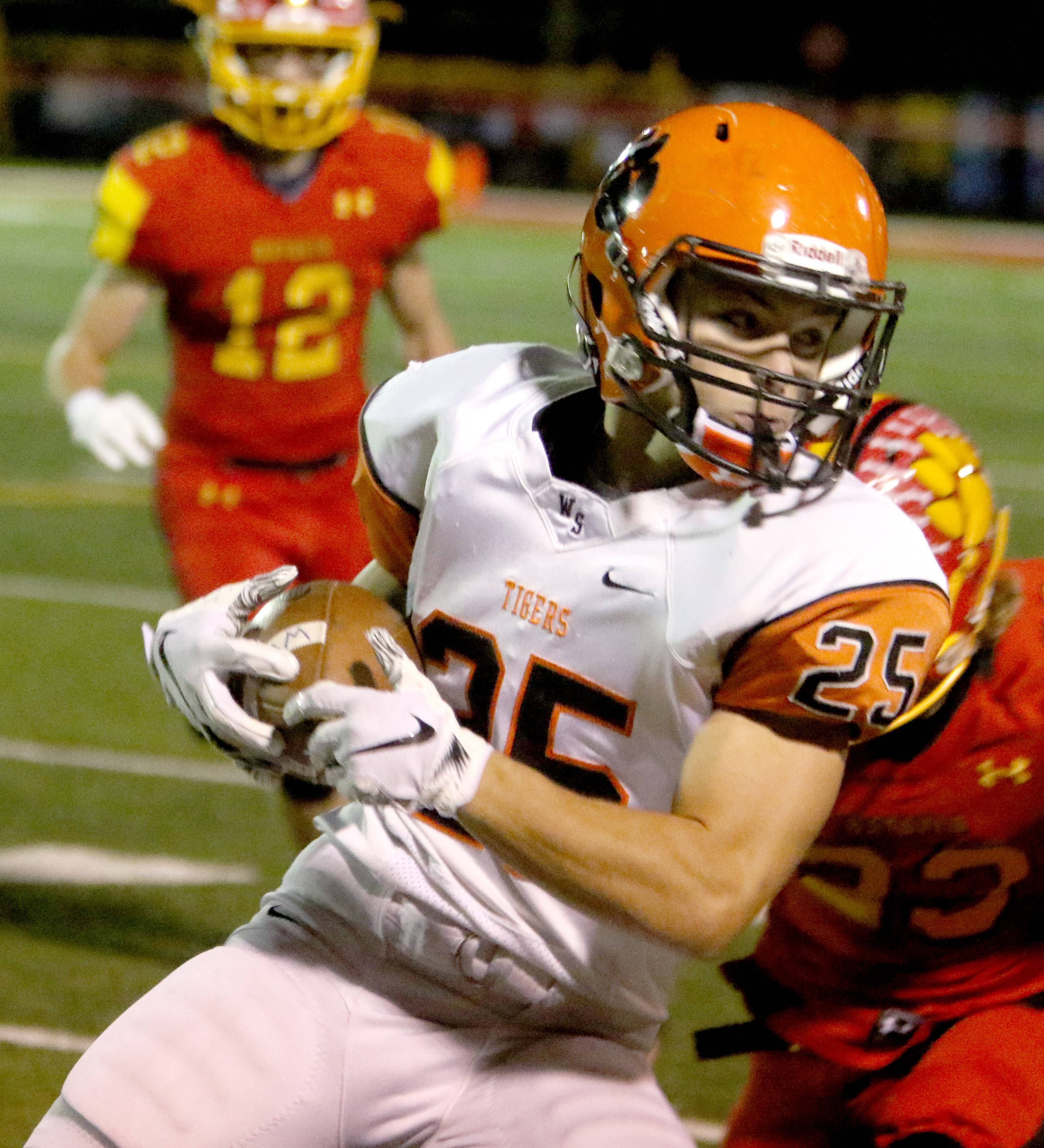 Wheaton Warrenville South's Jake Arthurs looks for running room during varsity football at Bulldog Stadium in Batavia Friday night.
