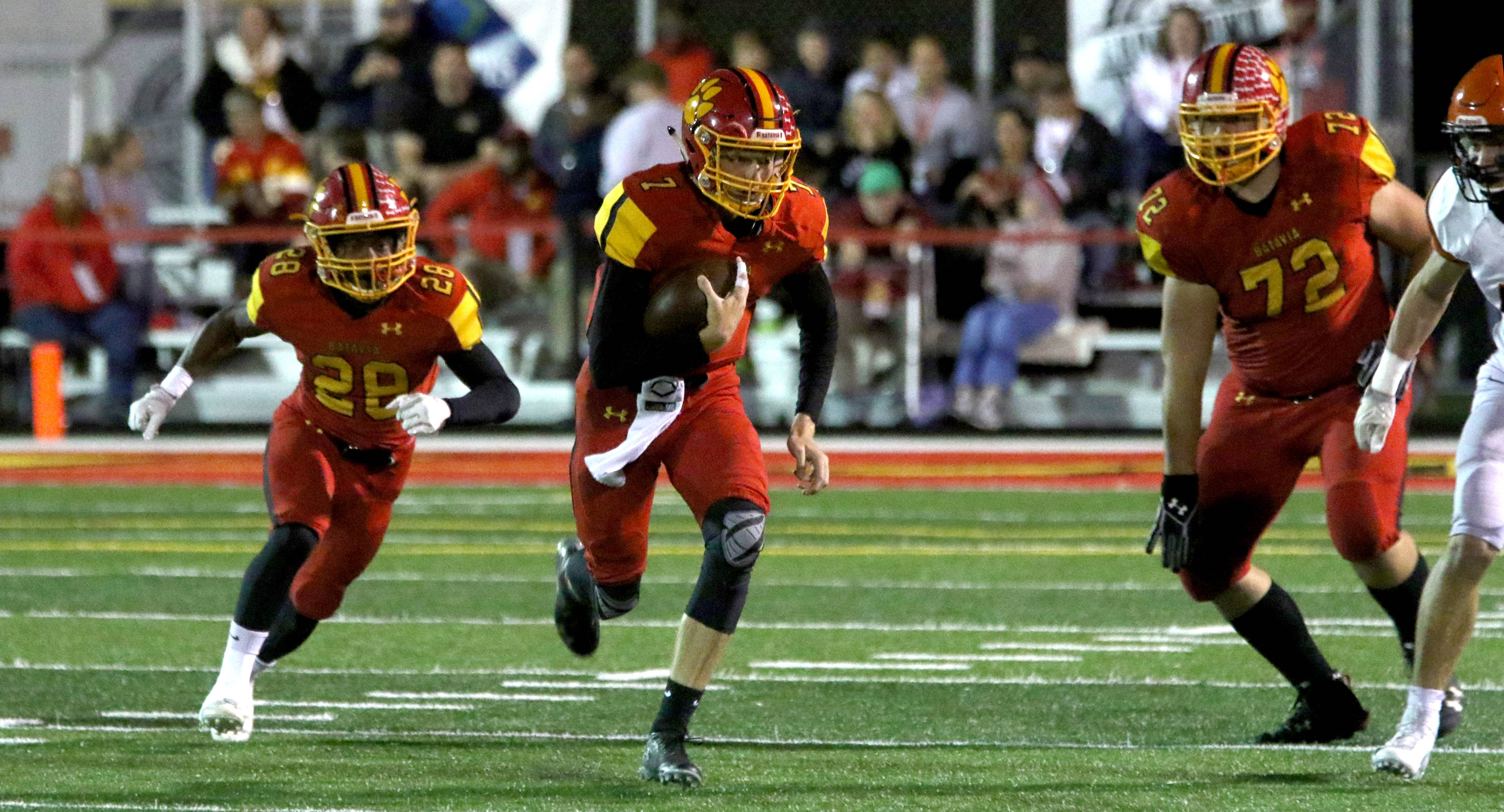 Batavia's Jack Meyers runs the ball against Wheaton Warrenville South during varsity football at Bulldog Stadium in Batavia Friday night.