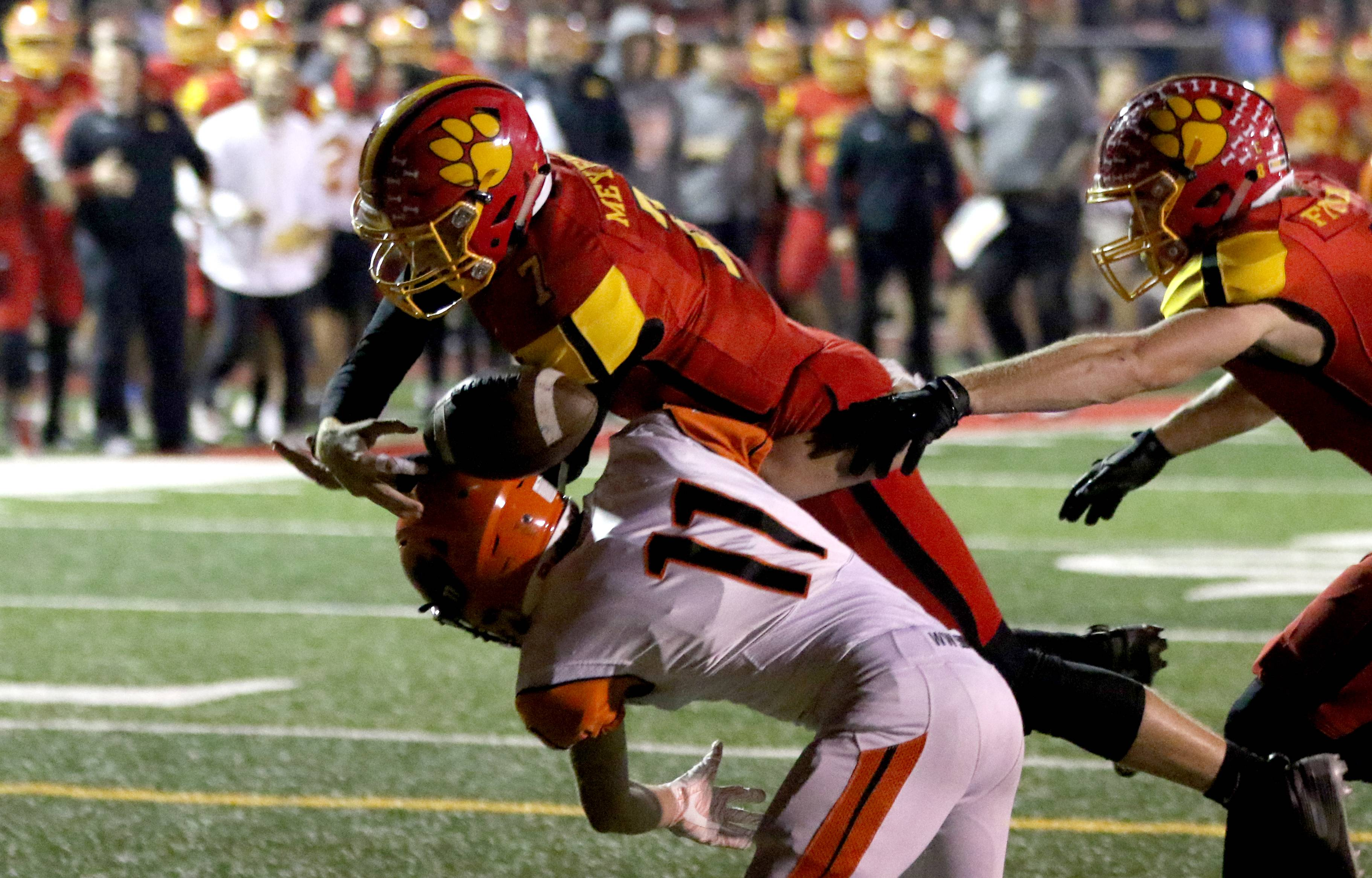 The ball pops loose from the hands of Batavia's Jack Meyers at the end zone against Wheaton Warrenville South at Bulldog Stadium in Batavia Friday night. Meyers recovered the ball for a touchdown.