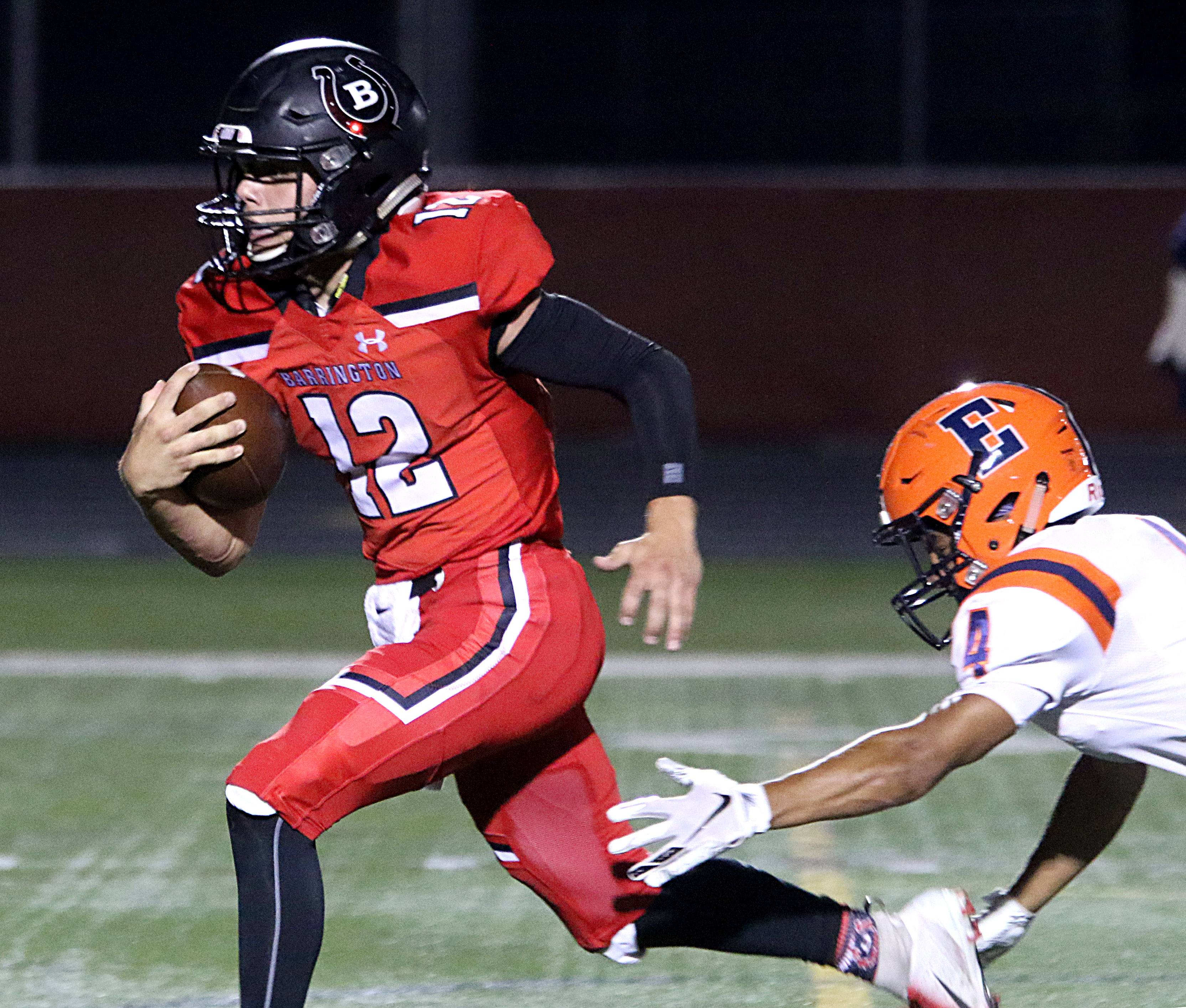 Barrington's Tommy Fitzpatrick runs in a first-quarter touchdown against Evanston earlier this season. Barrington will host Fremd Saturday afternoon in the Broncos' homecoming game.
