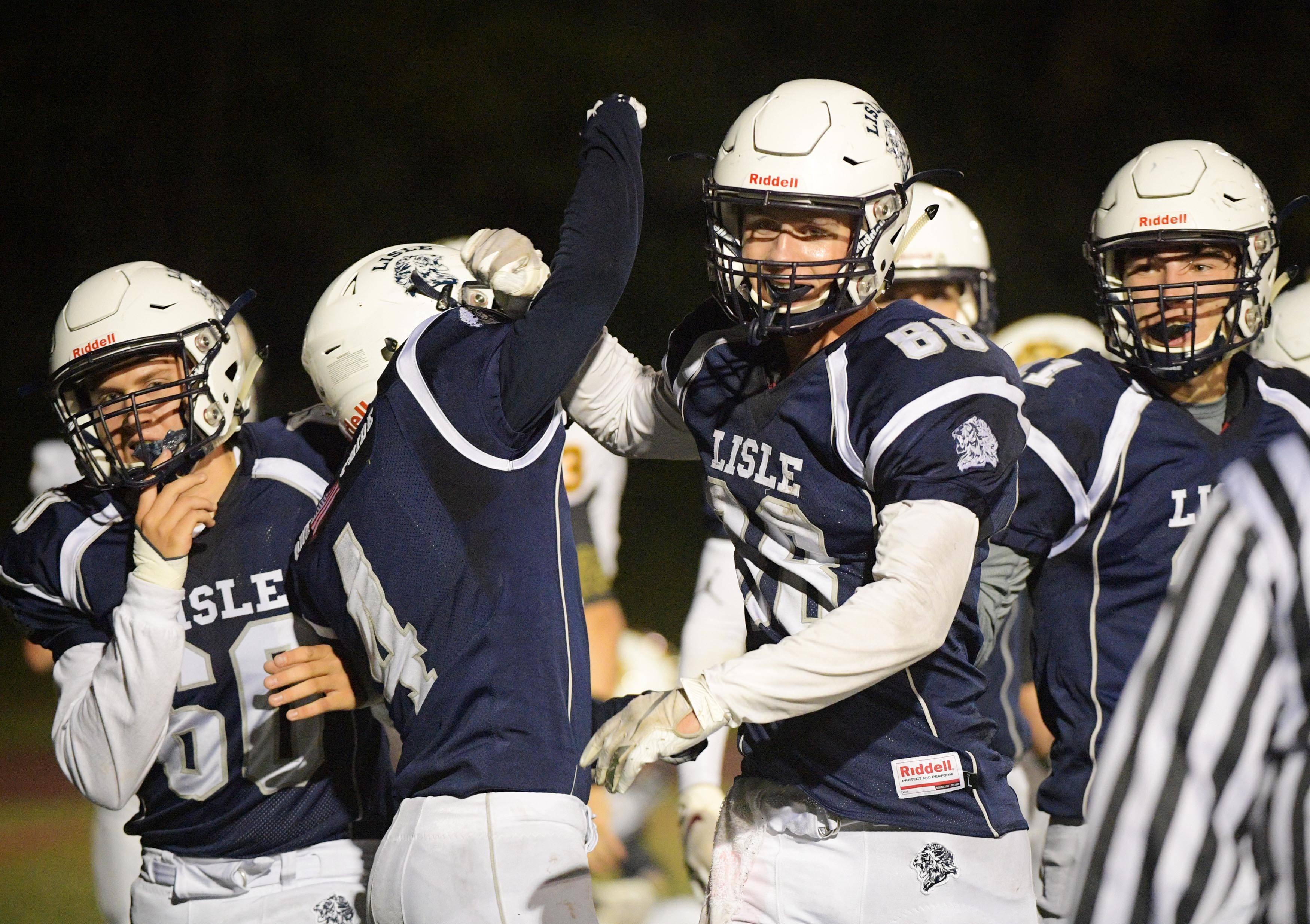 Lisle rallies to win in OT, clinch first league title since 1981