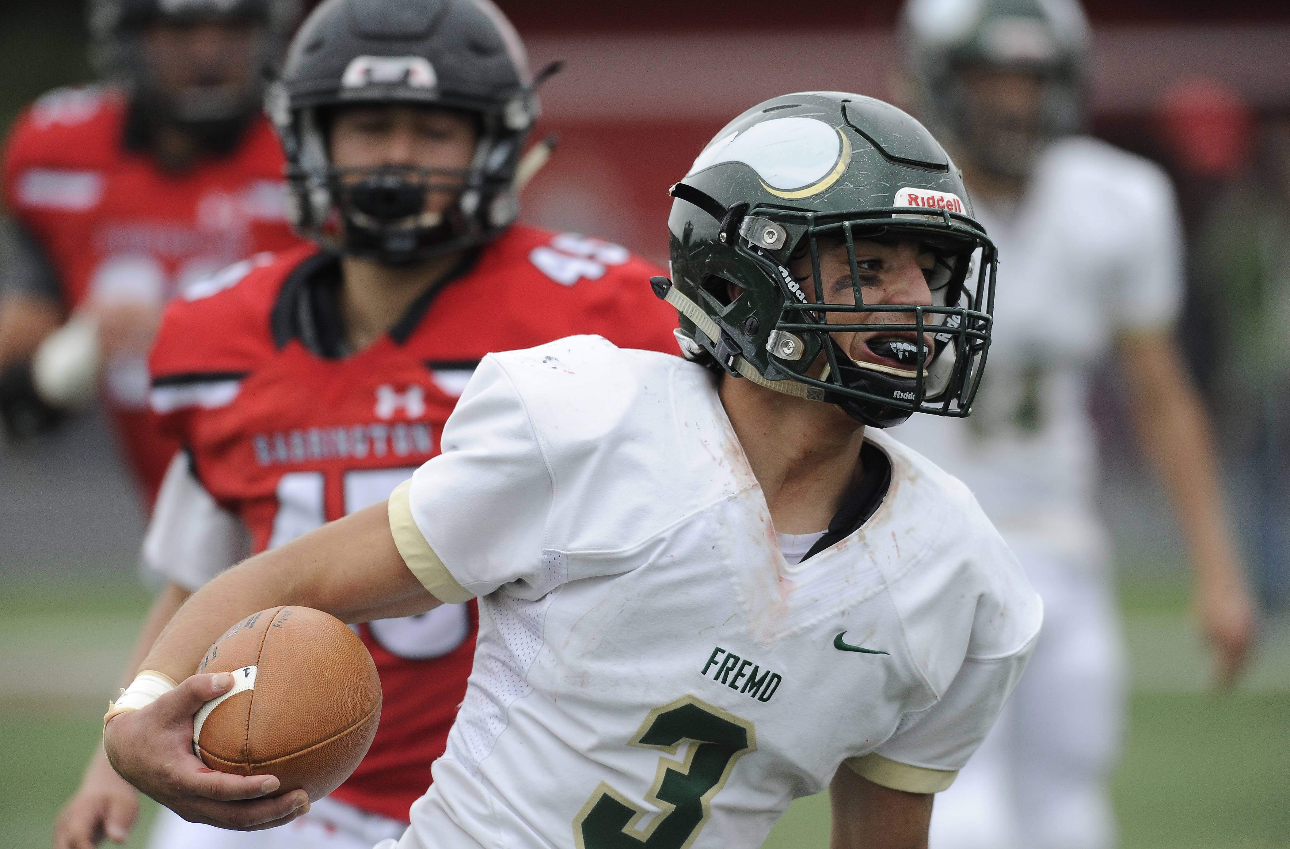 Fremd's Nick Rattin runs for yardage against Barrington last Saturday at Barrington. Fremd hosts Conant Friday night while Barrington entertains Hoffman Estates.
