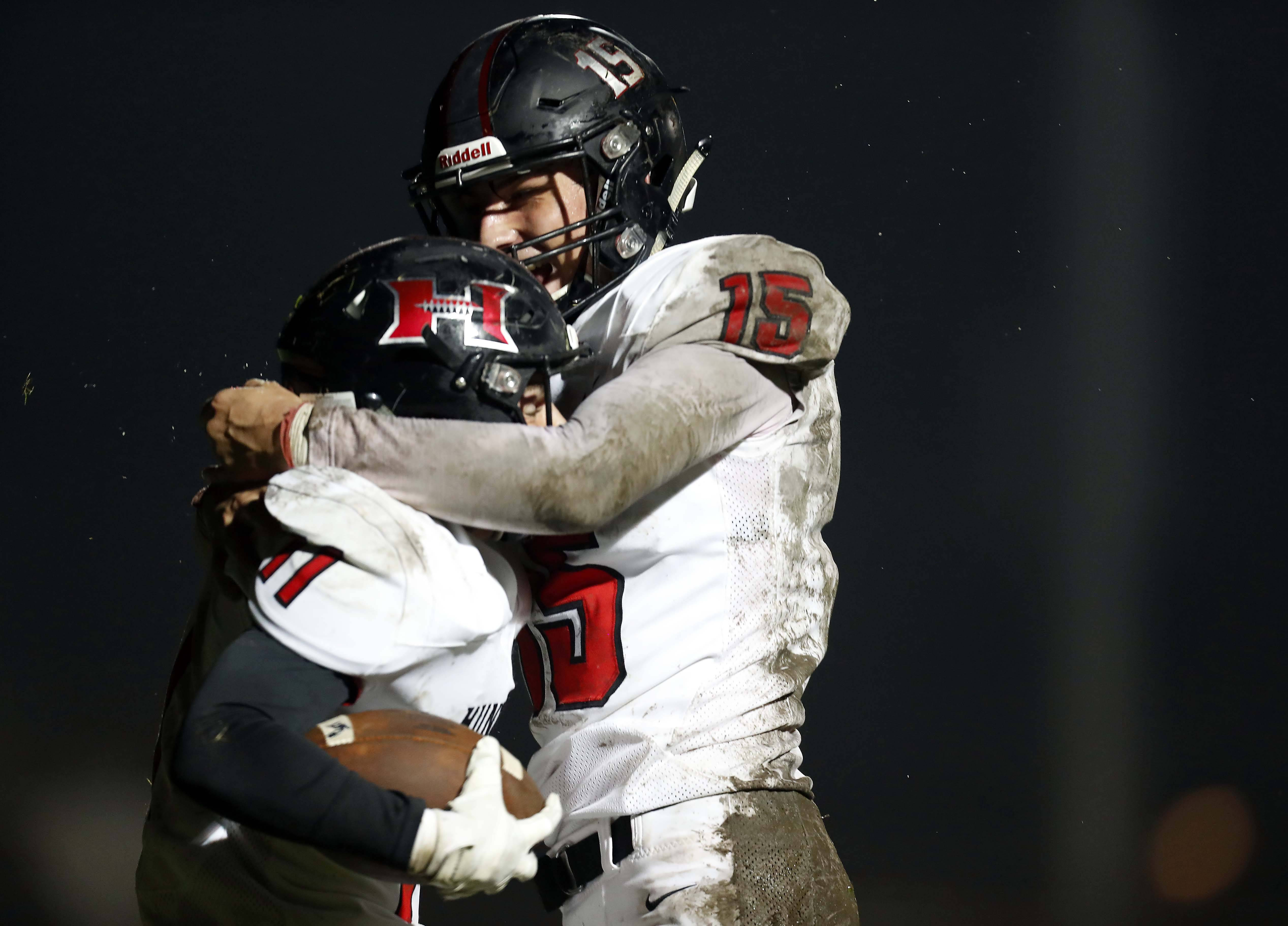 Huntley's Joey Cauldren (11) is embraced by Michael Boland (15) after his touchdown Friday during football in Hampshire.
