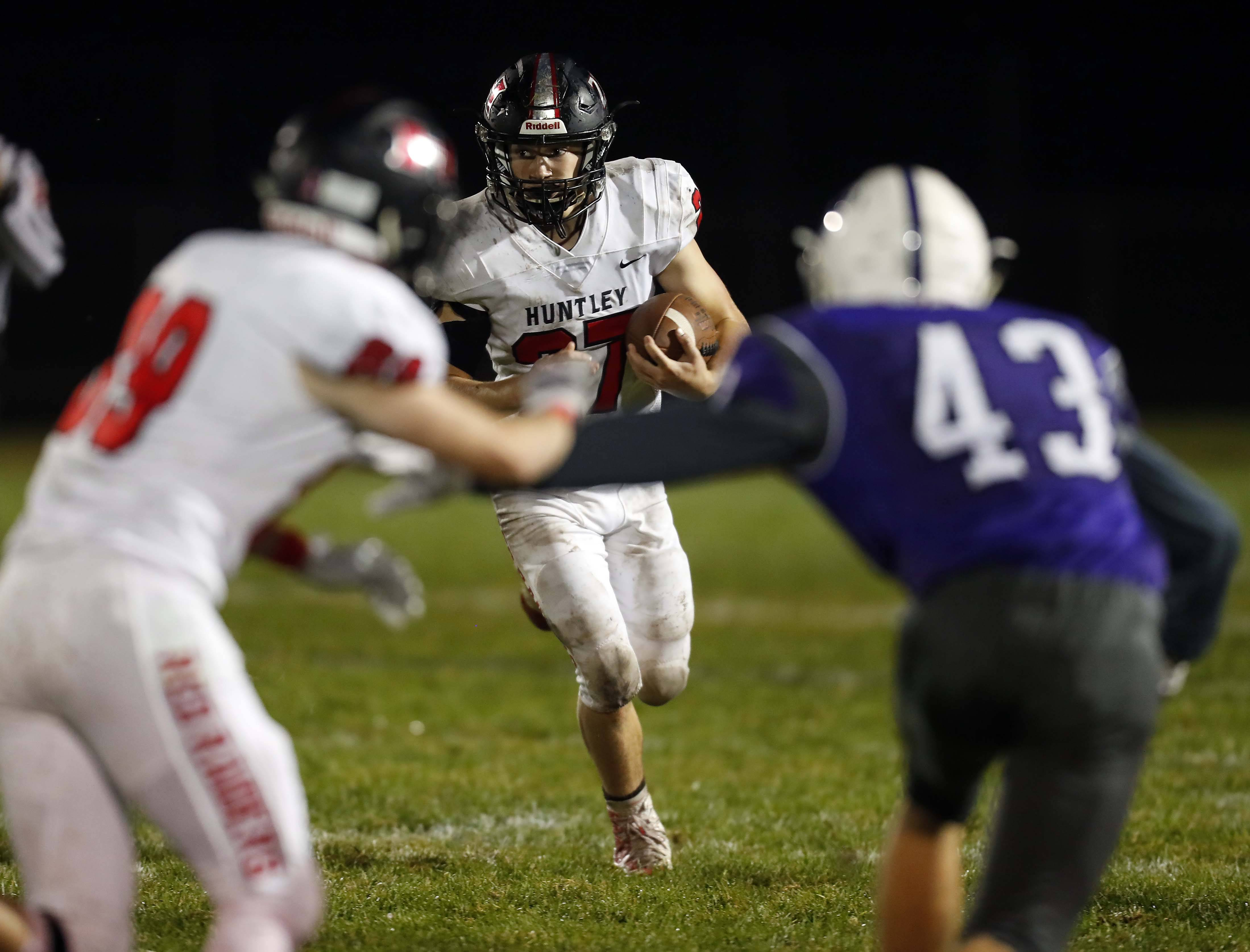 Huntley's Ryder Havens (27) looks for running room Friday during football in Hampshire.