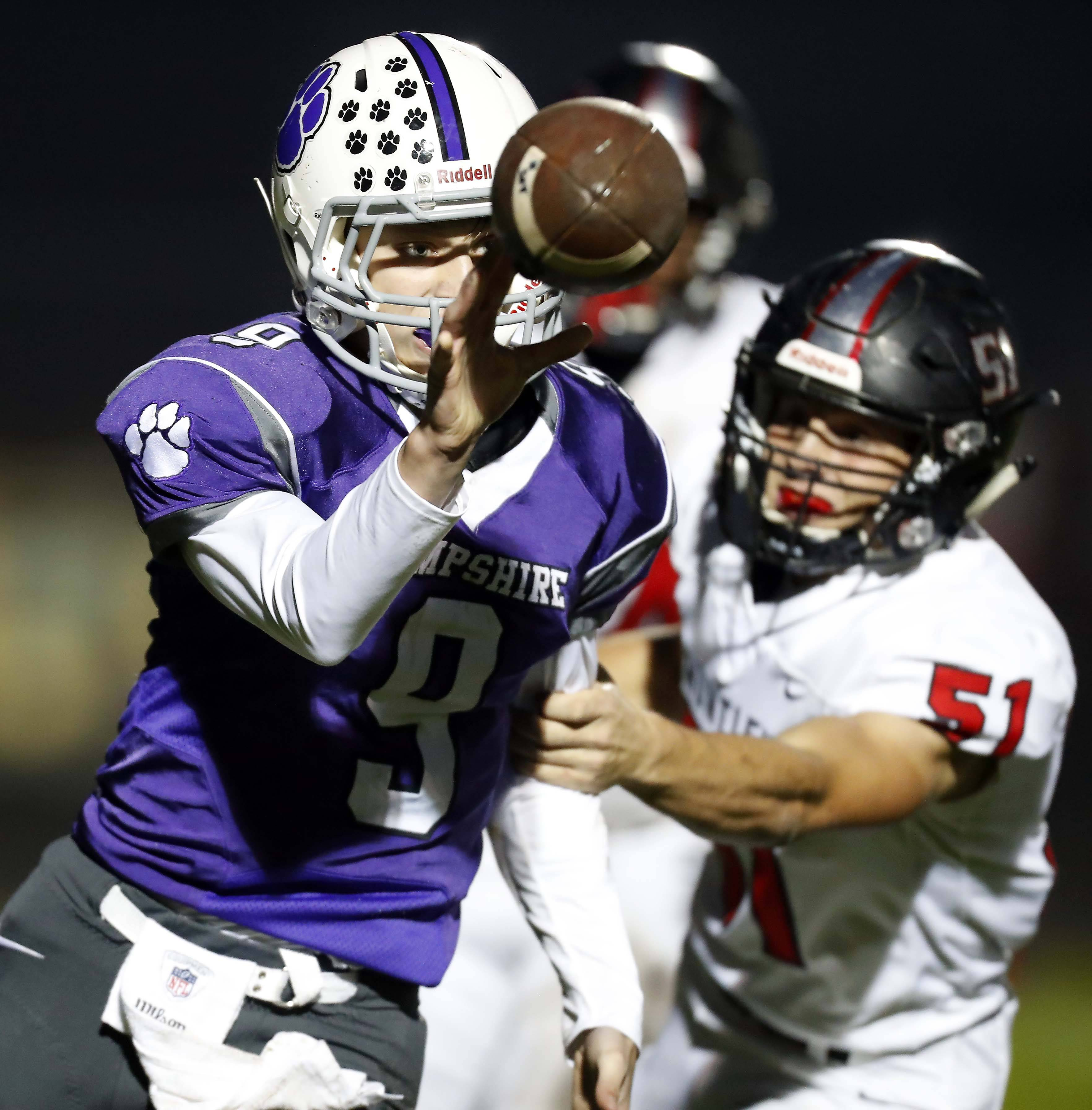 Hampshire's Jackson Milison (9) tosses the ball to his teammate just before Huntley's Zane Lucas (51) gets to him Friday.
