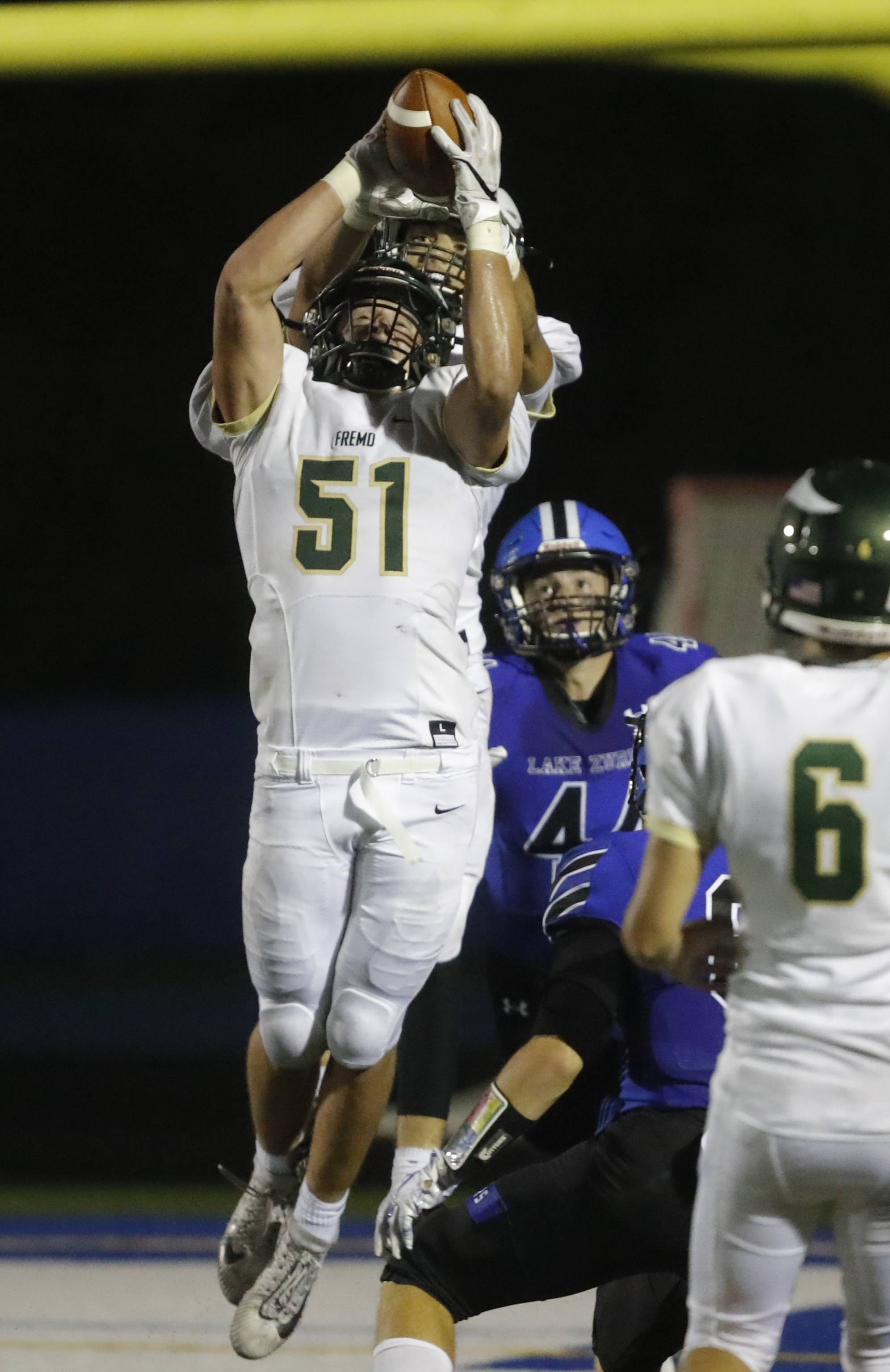 Fremd's Luke Bilek (51) makes an interception against Lake Zurich earlier this season. Fremd plays at Hoffman Estates Friday night.