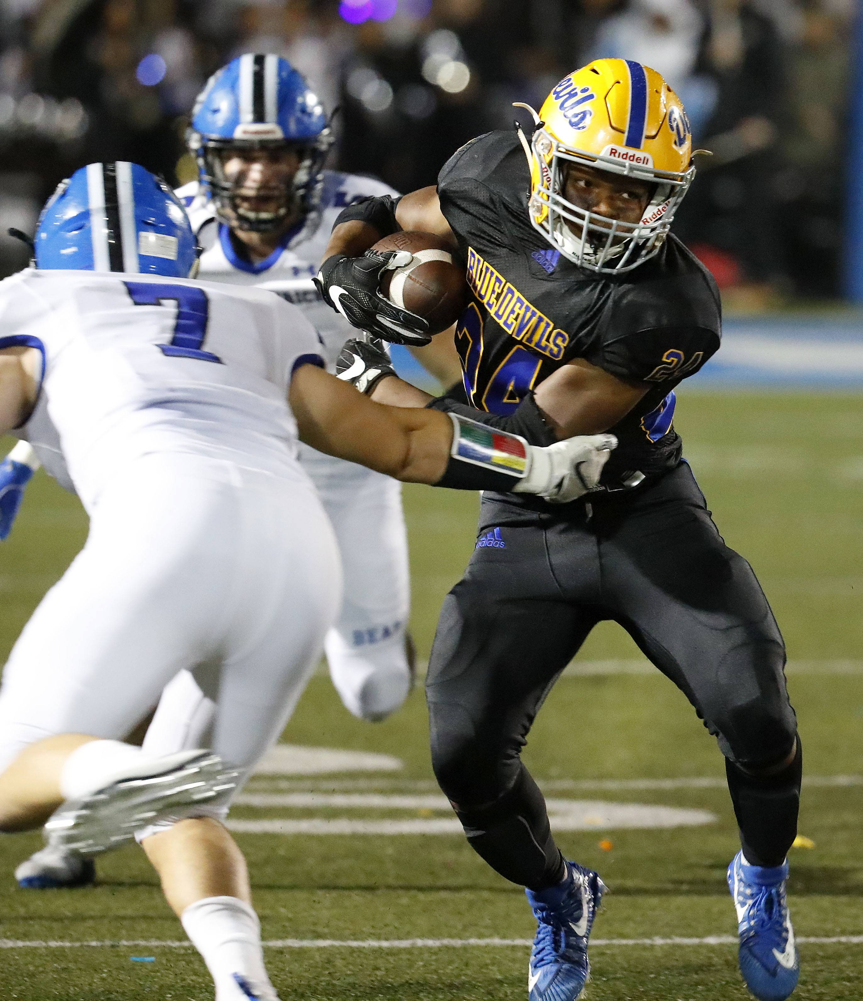 Warren's Martin Walker Jr., right, gets past Lake Zurich's Bryan Sanborn last week. Warren plays Stevenson Friday night for the North Suburban Conference title.