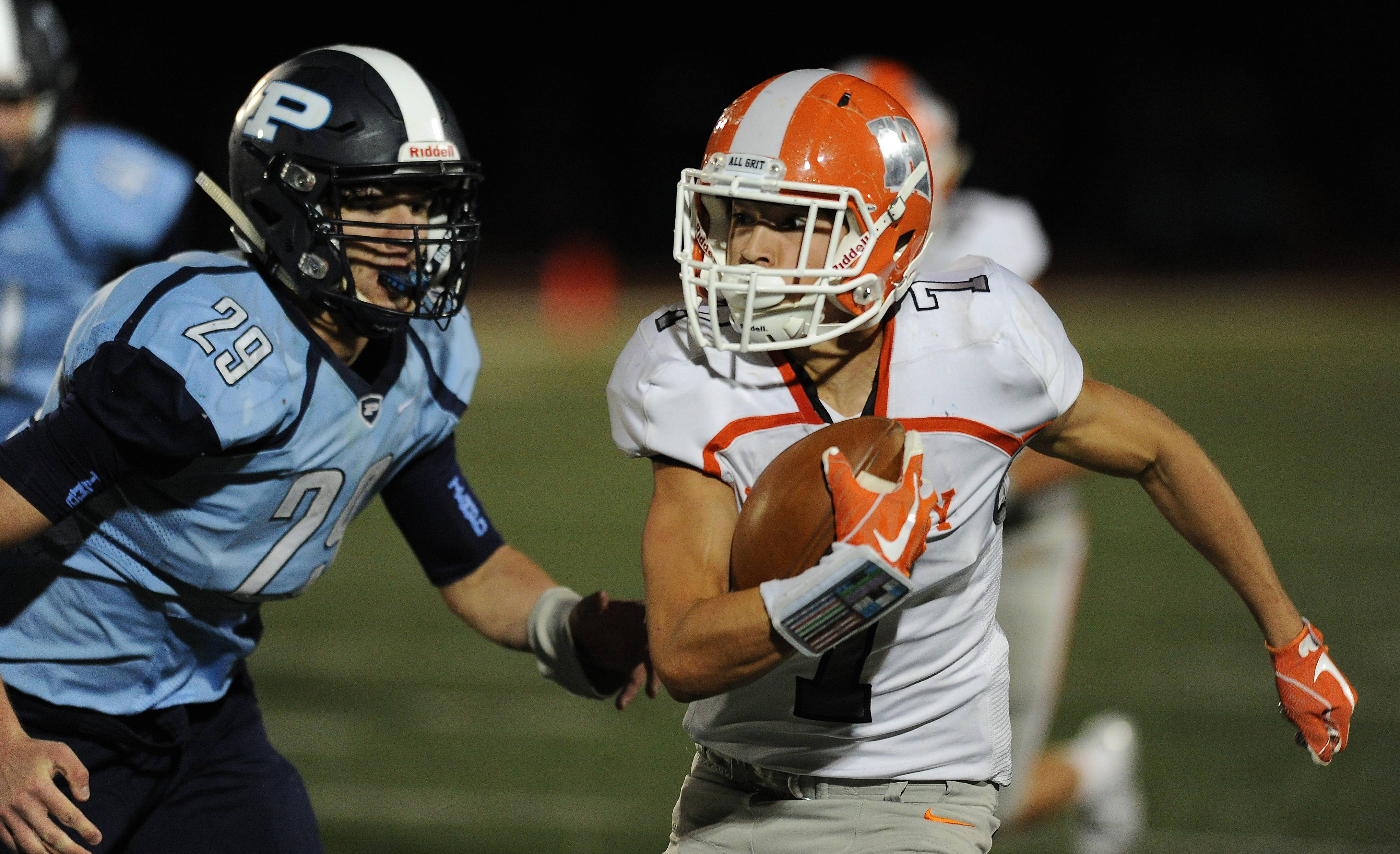 Hersey's Kapcer Rutkiewicz gains yardage  against Prospect earlier this season. Undefeated Hersey travels to undefeated Rolling Meadows Friday.