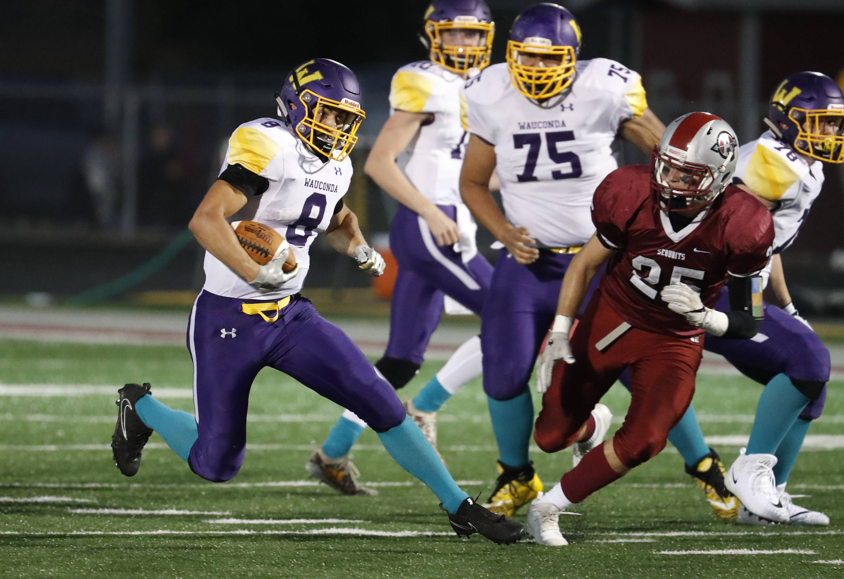 Wauconda's Eric Trela (8) looks to pick up yardage against Antioch earlier this season. Wauconda is at Cary-Grove Friday night in the first round of the Class 6A playoffs.