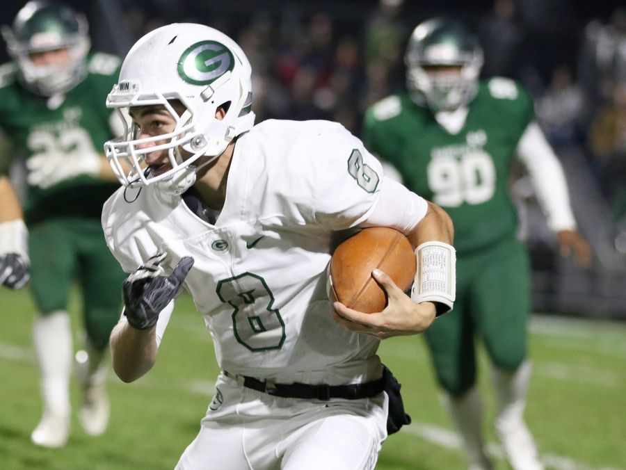 Glenbard West's Tommy Bleker runs the ball during first round playoff football action at Bartlett Friday night.