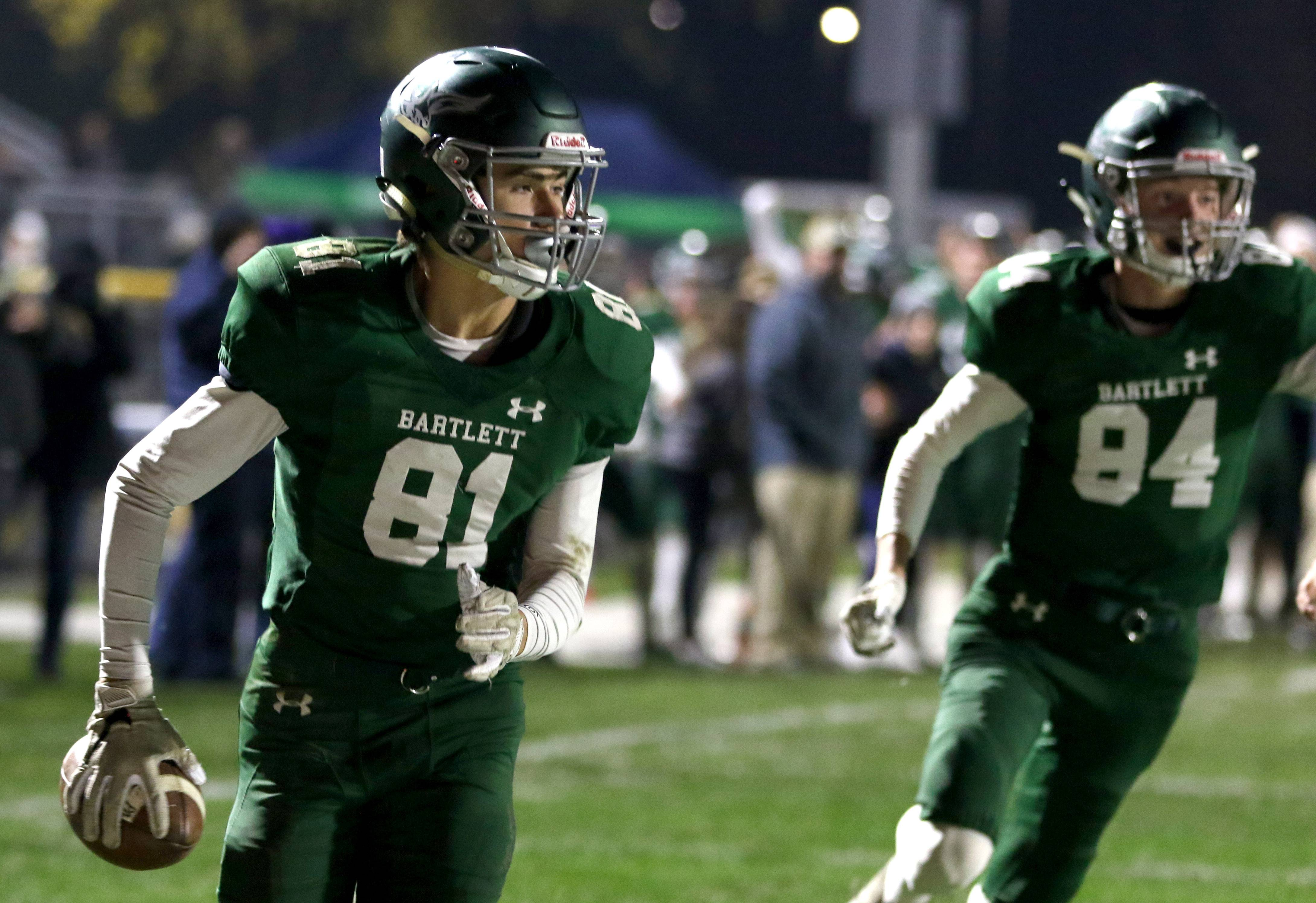 Bartlett's Mathew Young scampers in with a touchdown against Glenbard West during first round playoff football action at Bartlett Friday night.