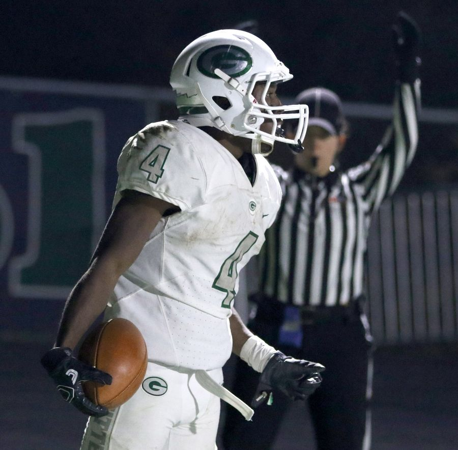 Glenbard West's Tyquan Cox scores a touchdown during first round playoff football action at Bartlett Friday night.
