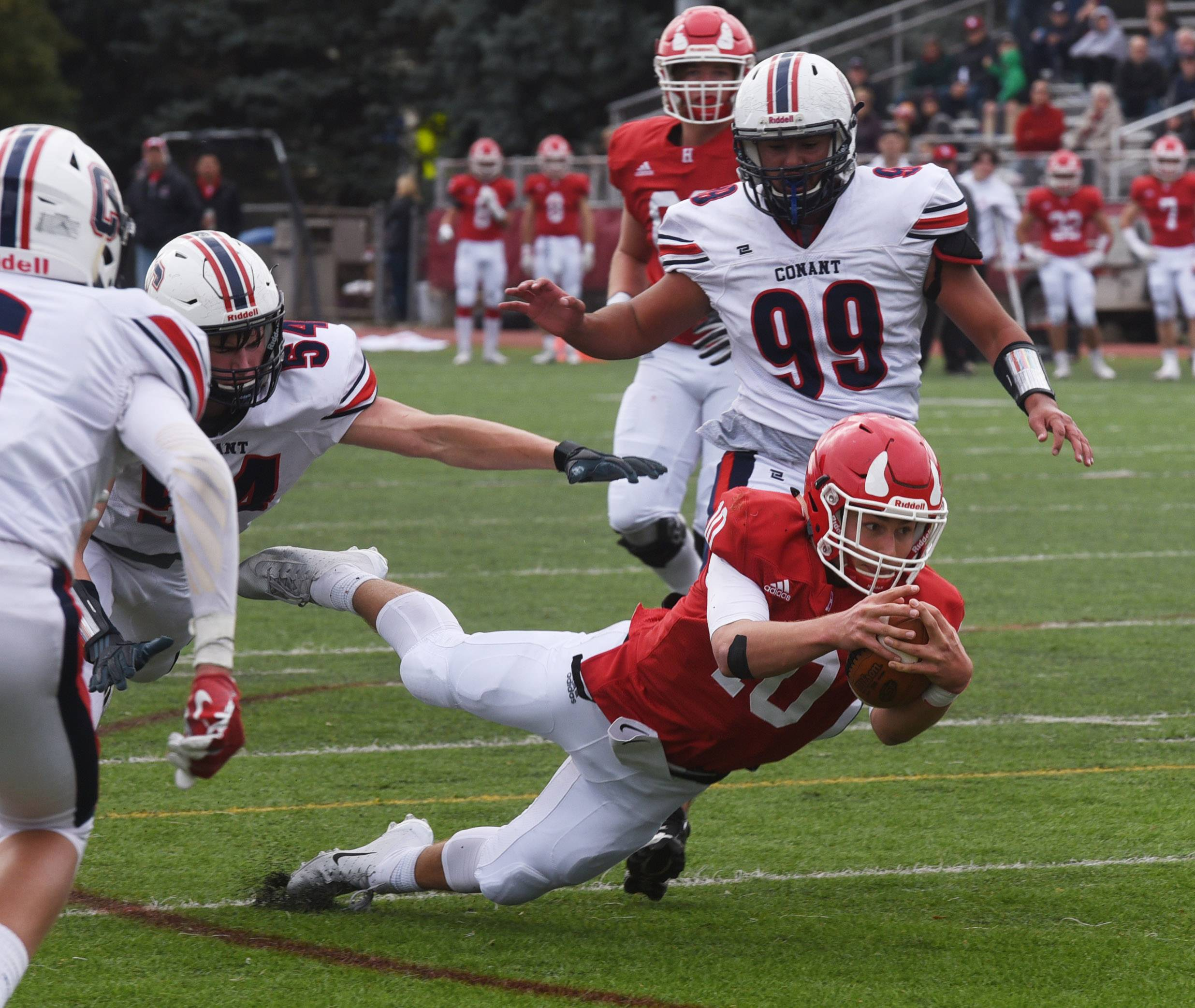 Hinsdale Central quarterback Matthew Rush stretches for extra yardage against Conant during Saturday's Class 8A playoff game in Hinsdale.
