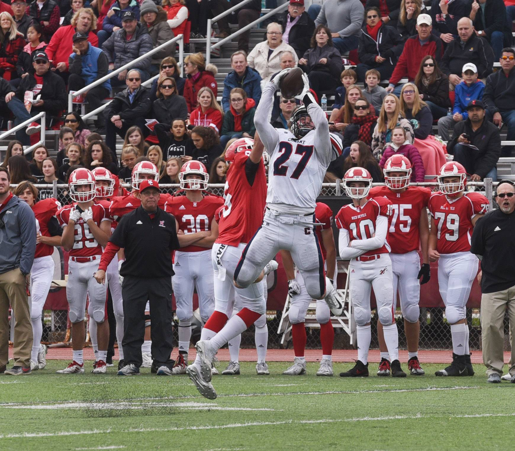 Conant's Anthony Wachal catches a pass during Saturday's Class 8A playoff game against Hinsdale Central.