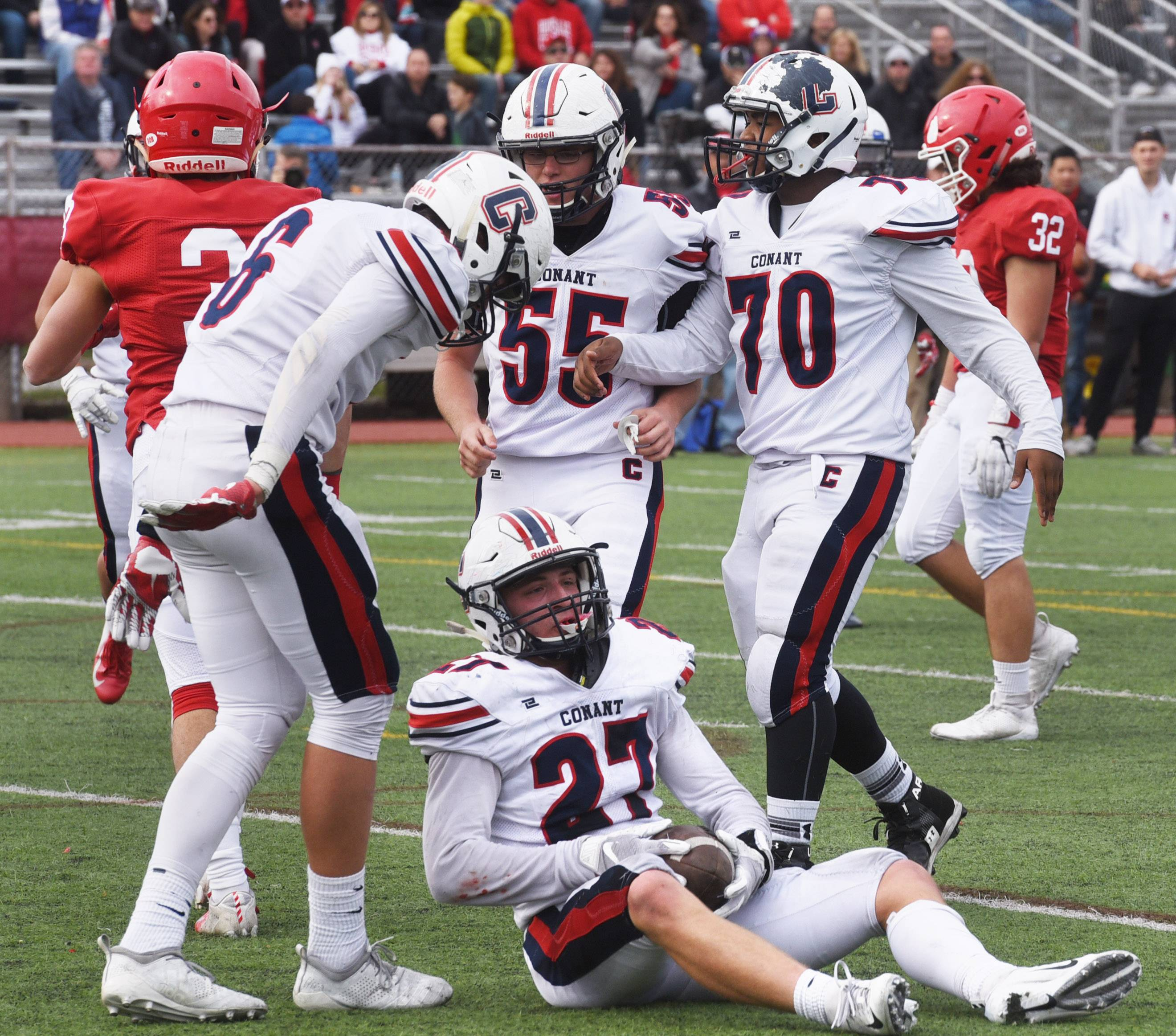 Conant's Anthony Wachal (27) gathers himself after being tackled just past the goal line while scoring a touchdown during Saturday's Class 8A playoff game against Hinsdale Central.