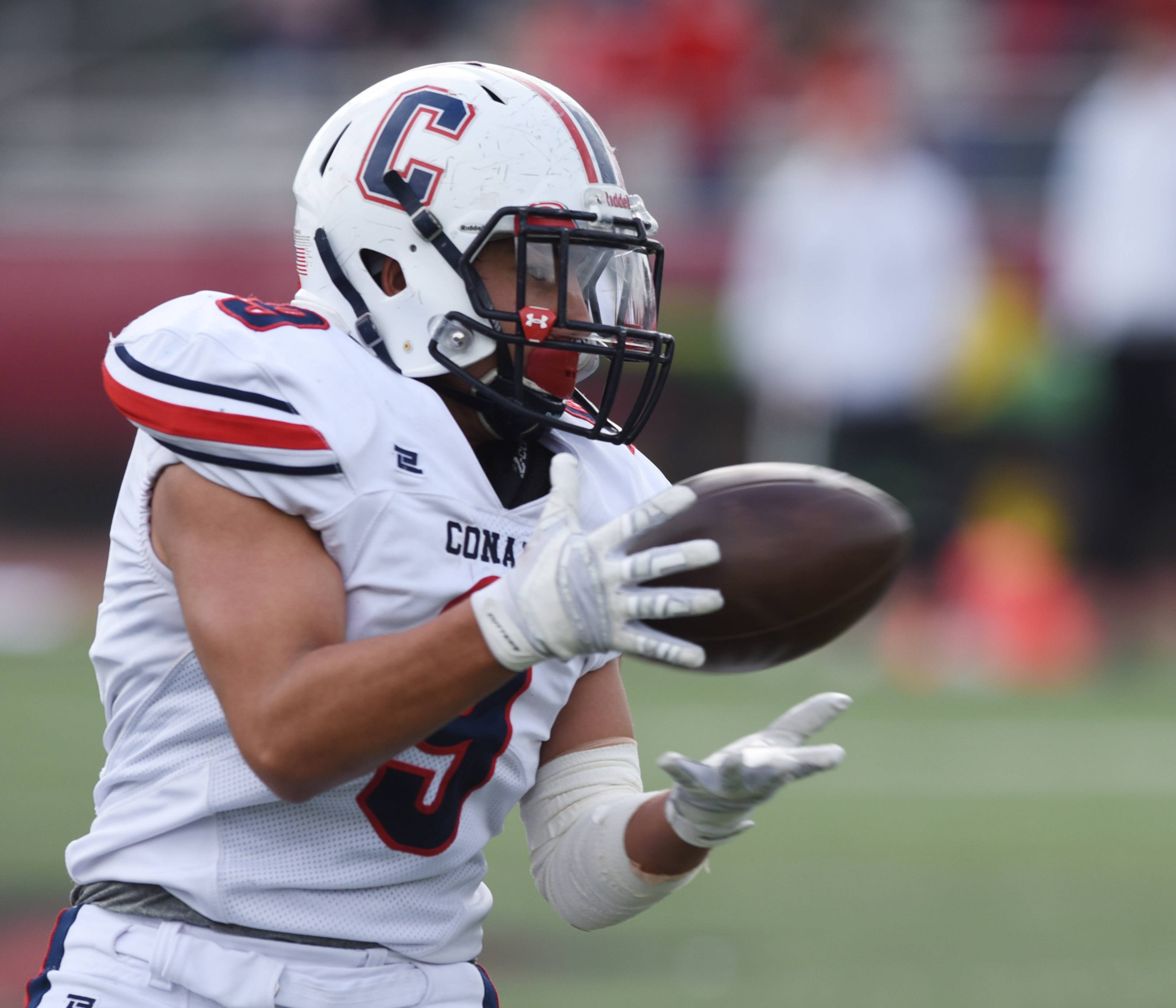 Conant's Joseph Perez catches a pass during Saturday's Class 8A playoff game against Hinsdale Central.