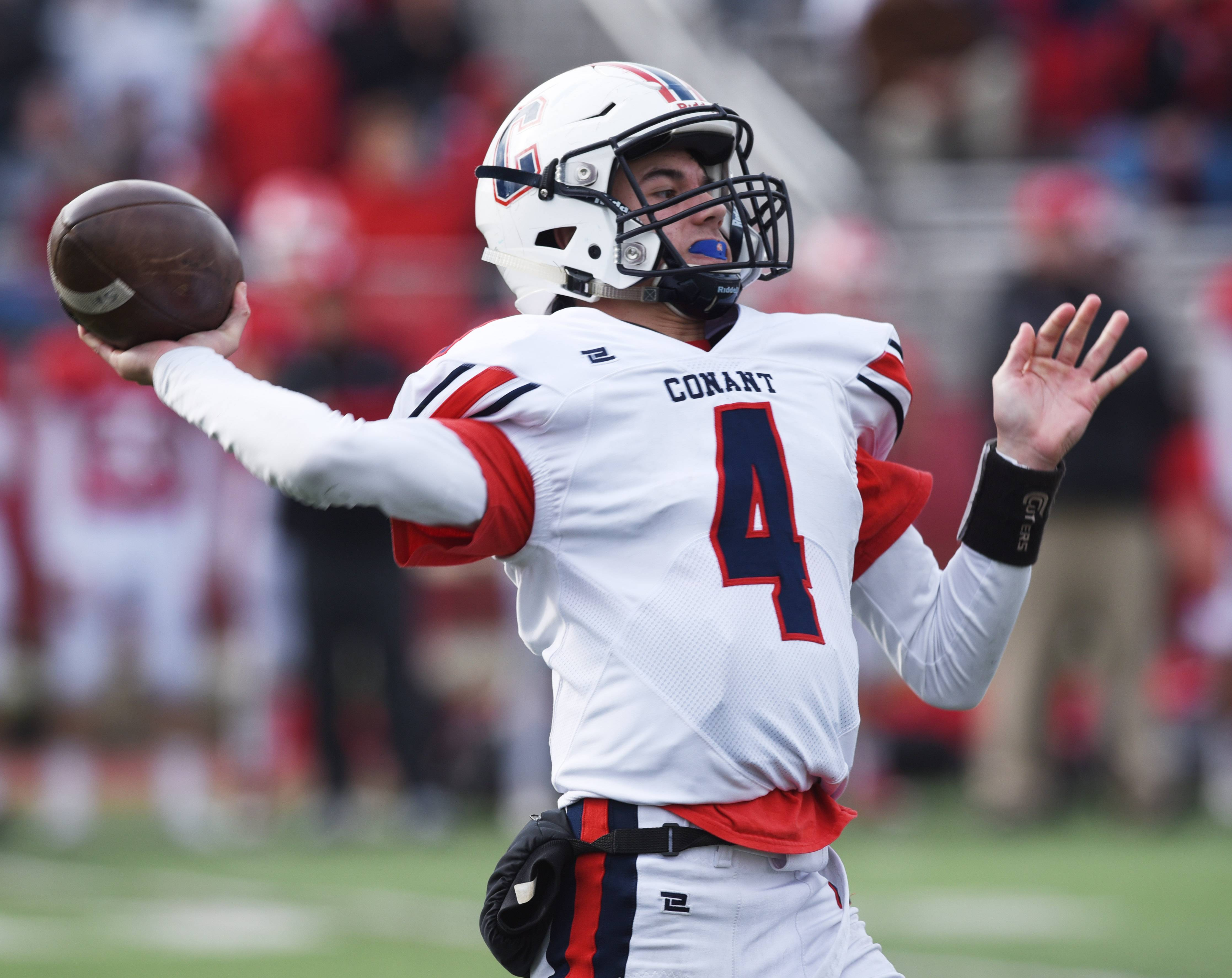 Conant quarterback Kevin Polaski throws a pass during Saturday's Class 8A playoff game in Hinsdale.