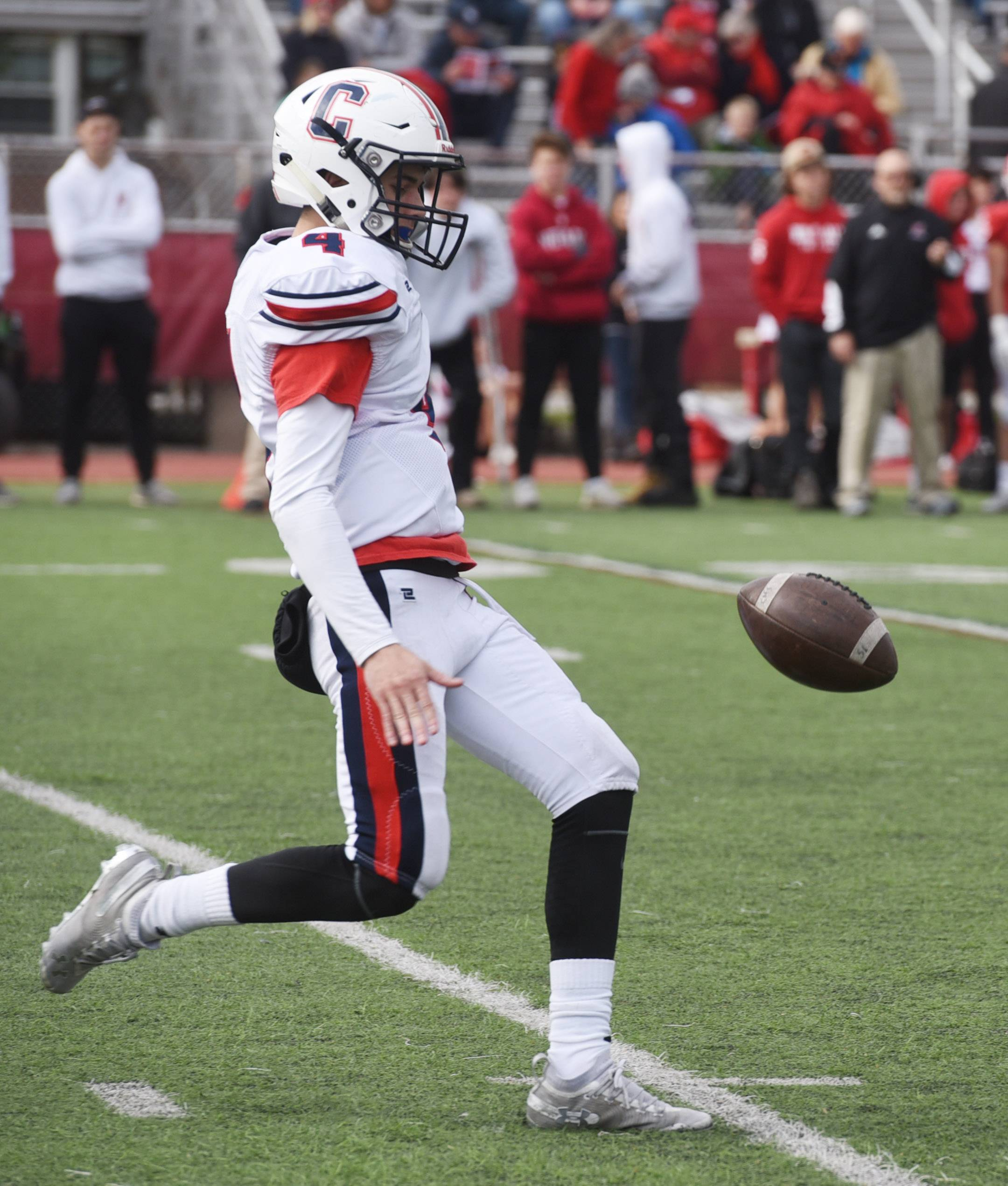 Conant's Kevin Polaski punts during Saturday's Class 8A playoff game against Hinsdale Central.