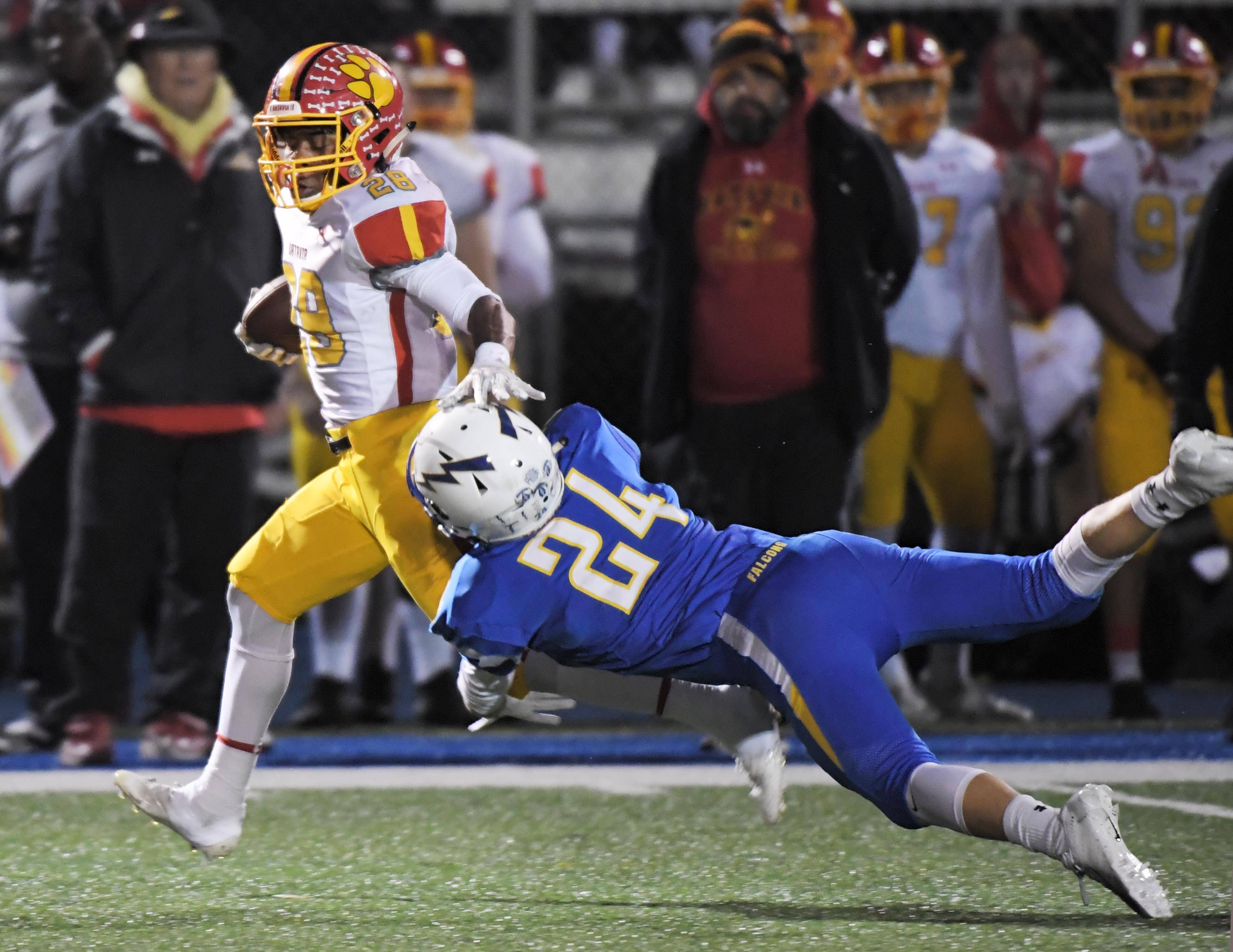Batavia's Artavion Taylor escapes Wheaton North's Tommy Gubenko during a regular season win in Week 9. The Bulldogs host Moline in the second round of the Class 7A playoffs Saturday.
