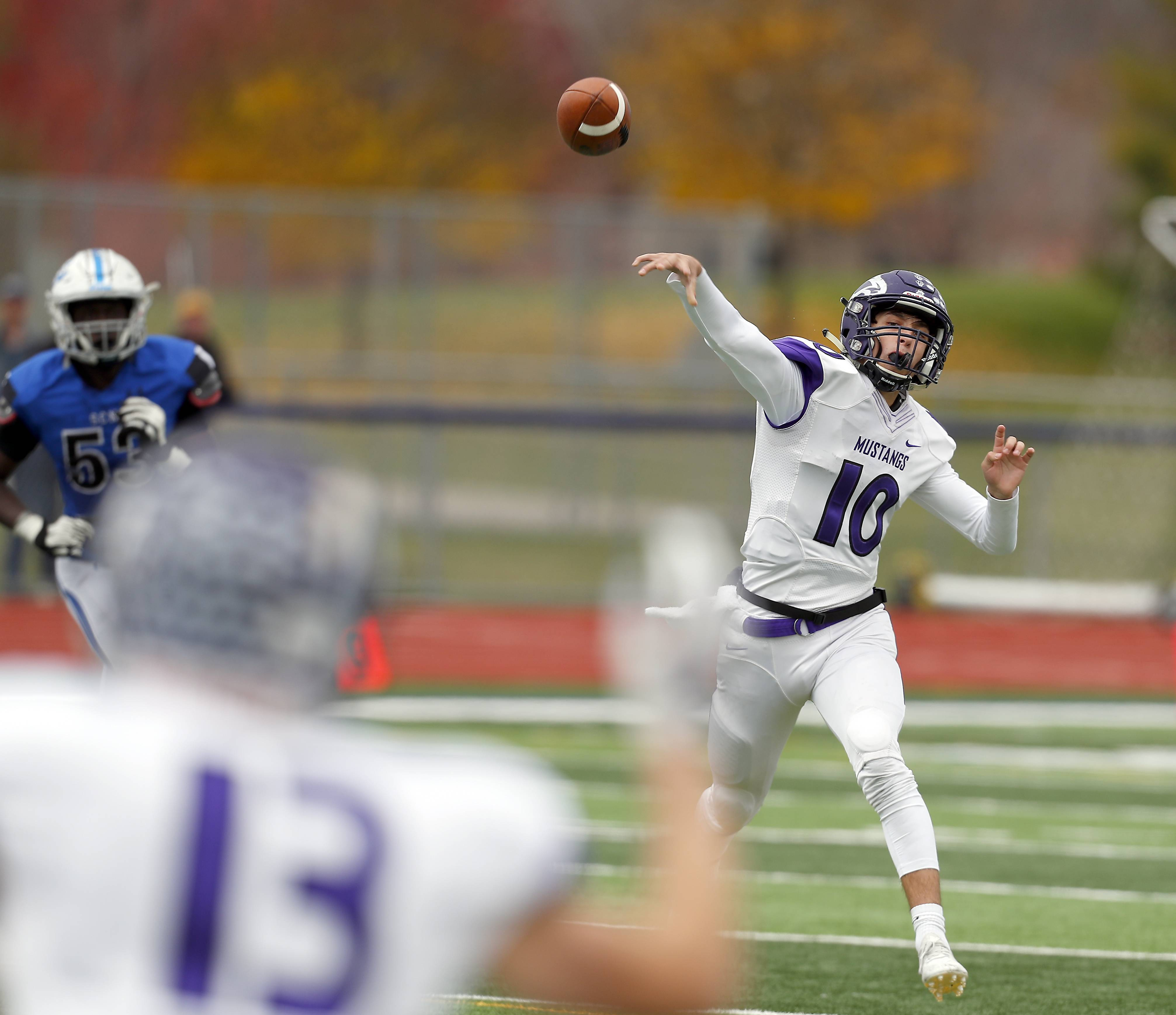Rolling Meadows' Arkadiusz Kleniuk (10) throws to Rolling Meadows' Justin Kretz (13) Saturday during IHSA Class 7A playoff football in St. Charles.