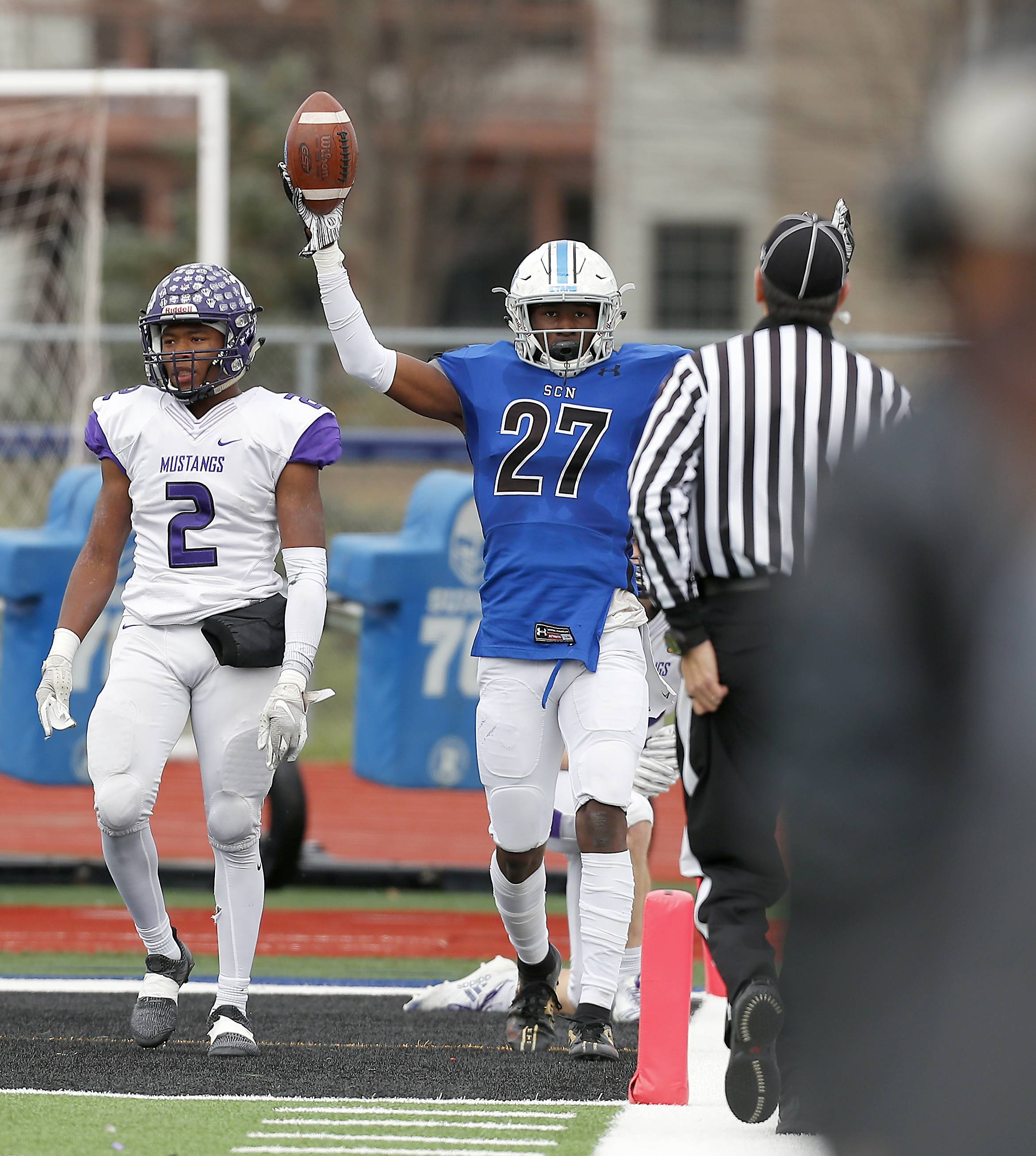 St. Charles North's Tyler Nubin (27) celebrates a touchdown Saturday during IHSA Class 7A playoff football in St. Charles.