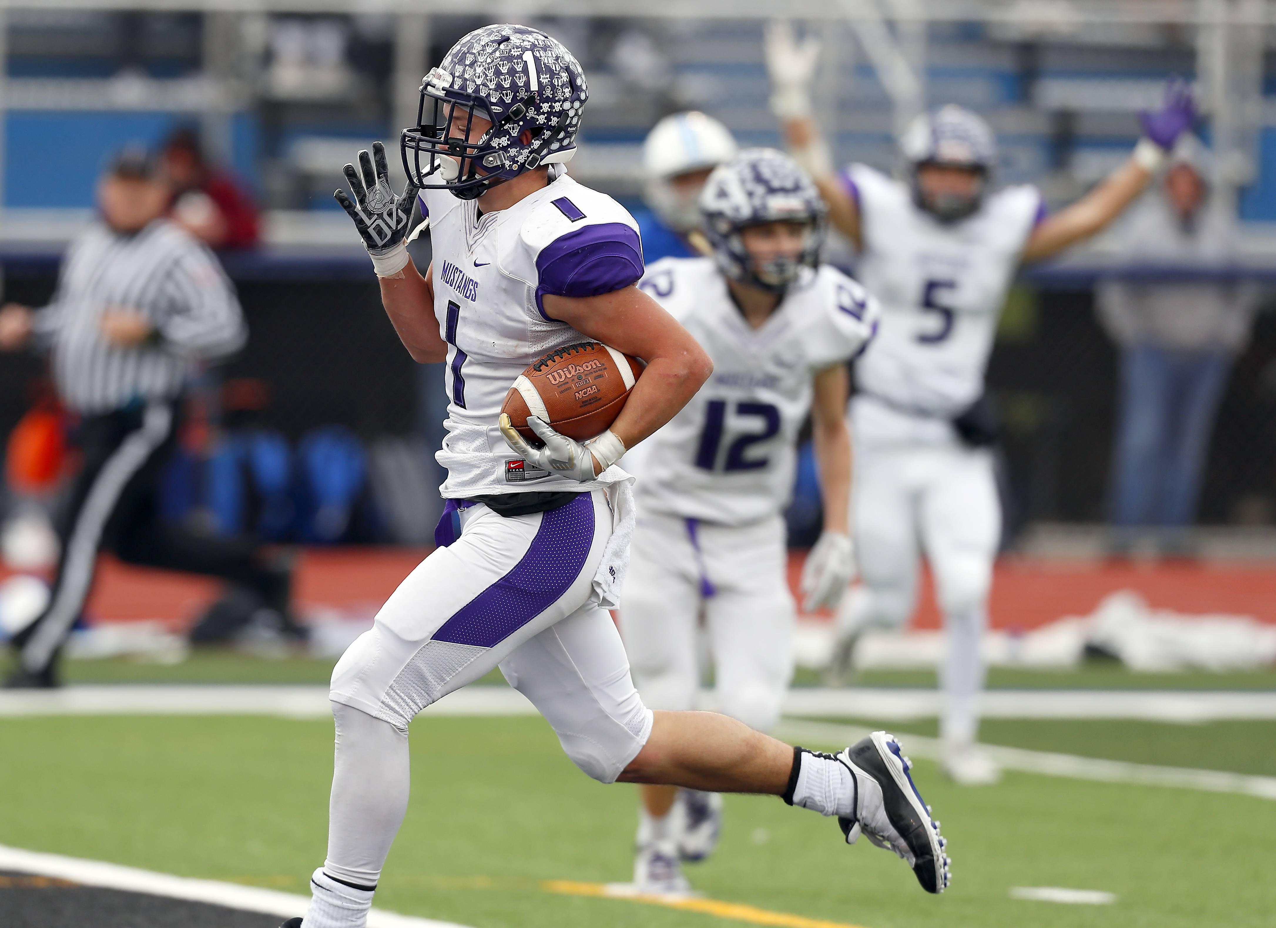 Rolling Meadows' Jace O'Hara (1) heads in the end zone Saturday during IHSA Class 7A playoff football in St. Charles.