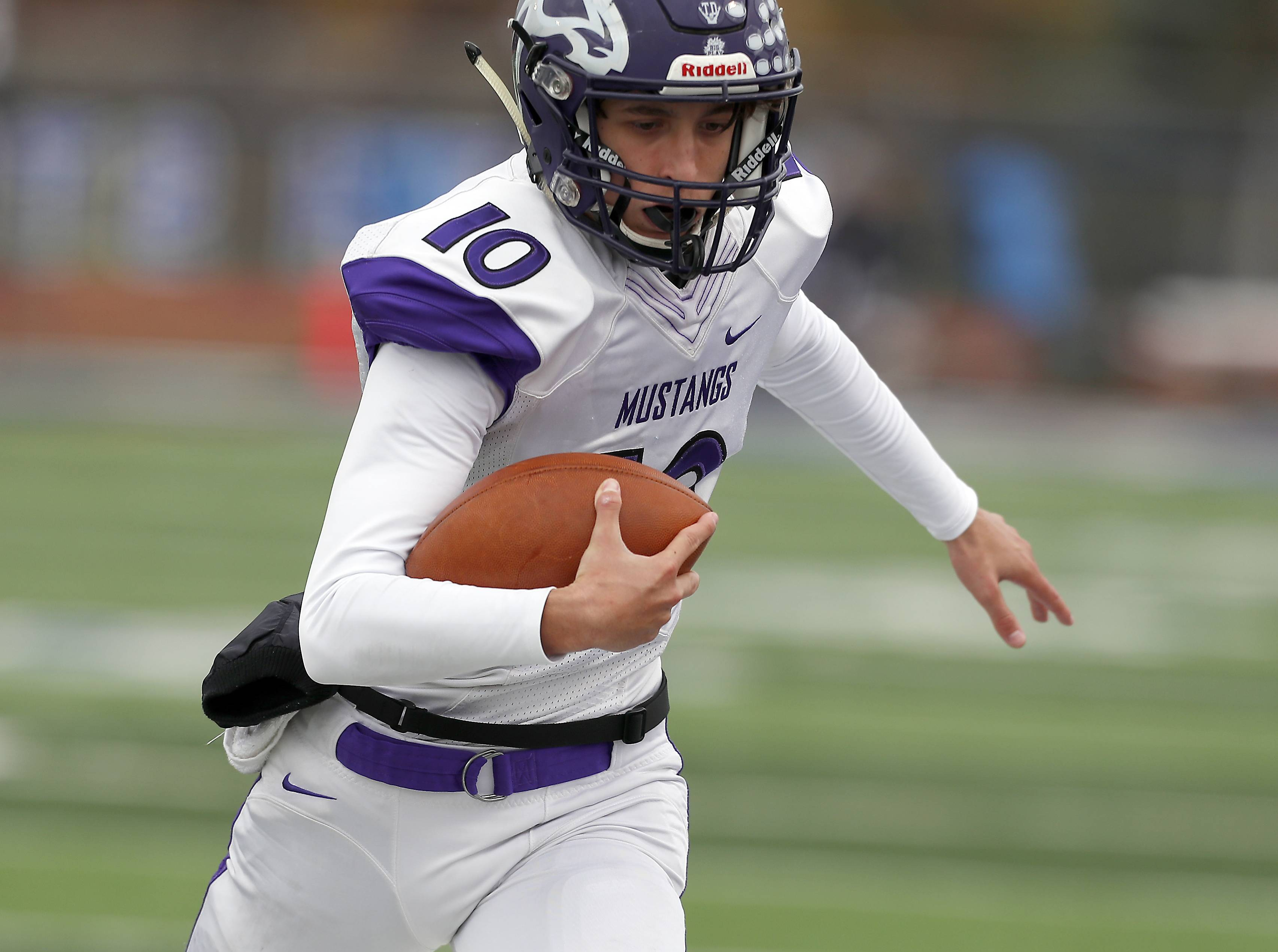 Rolling Meadows' Arkadiusz Kleniuk (10) Saturday during IHSA Class 7A playoff football in St. Charles.