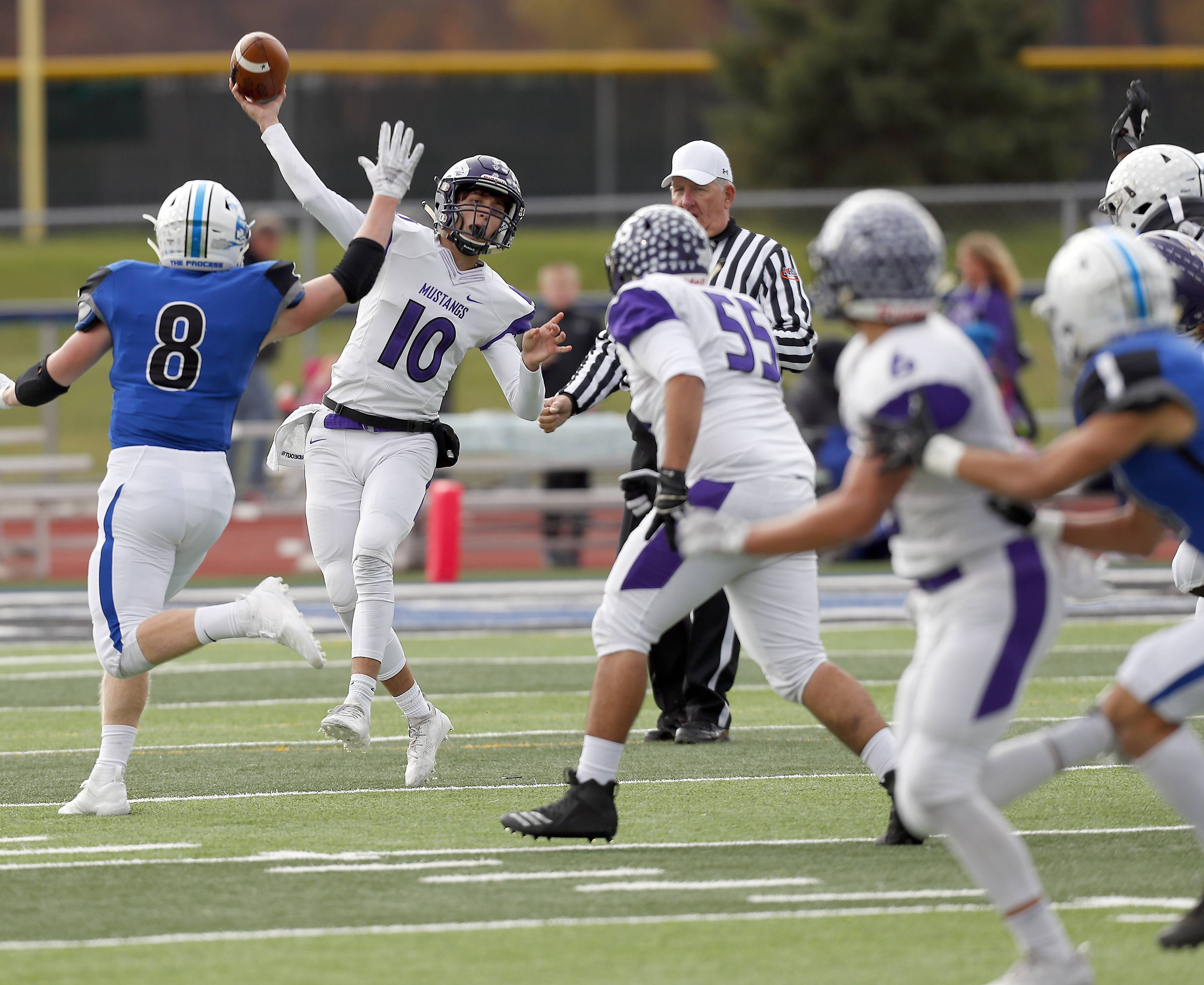 Rolling Meadows' Arkadiusz Kleniuk (10) throws over St. Charles North's Ben Furtney (8) Saturday during IHSA Class 7A playoff football in St. Charles.
