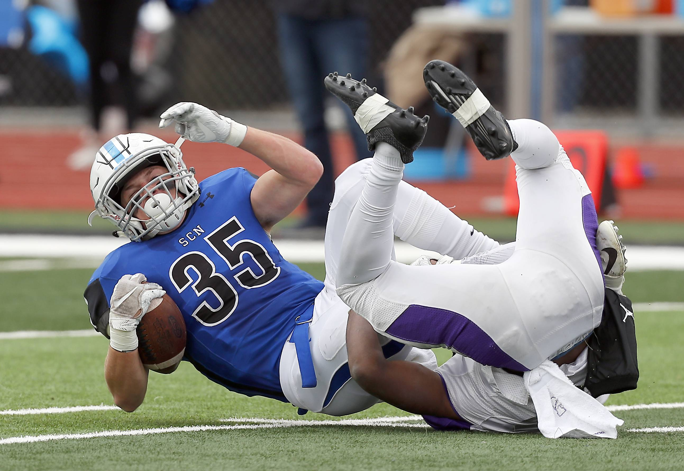St. Charles North's Nicholas DeMarco (35) Saturday during IHSA Class 7A playoff football in St. Charles.