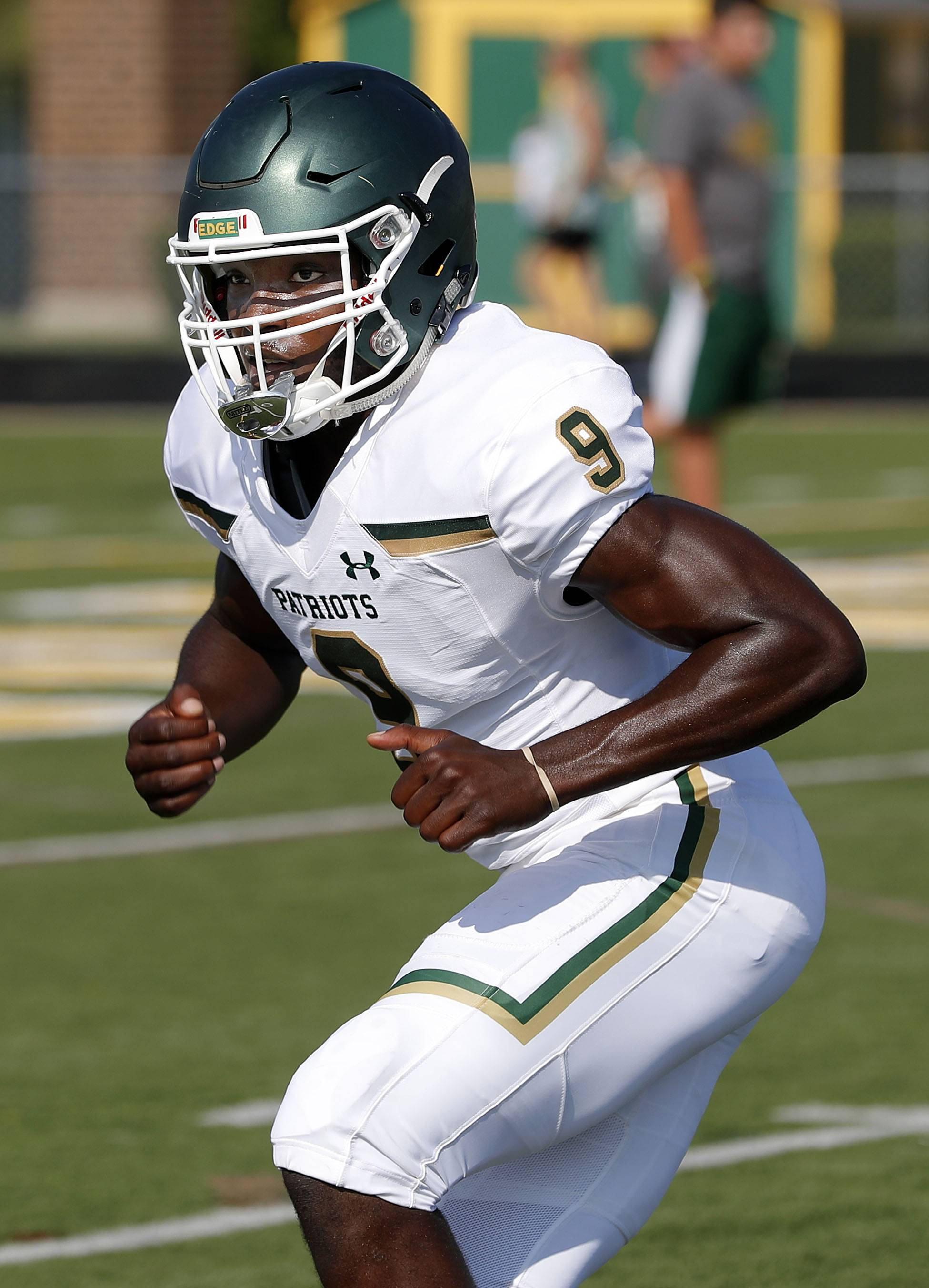 Stevenson linebacker Maema Njongmeta had more than 20 college scholarship offers before verbally committing to the University of Wisconsin over the weekend.