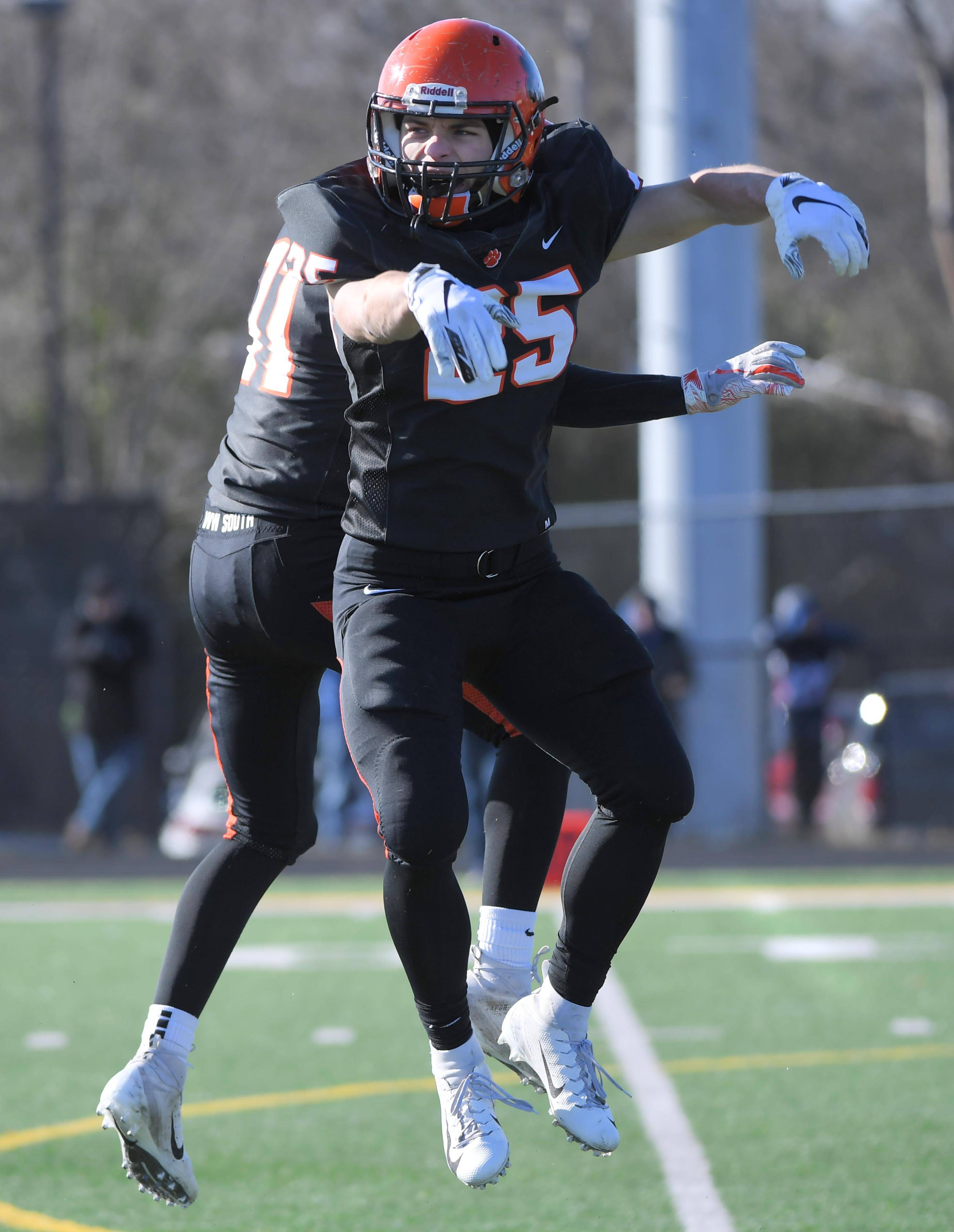 Wheaton Warrenville South's Jake Arthurs reacts after his first quarter touchdown against St. Charles North Saturday in a quarterfinal playoff football game in Wheaton.