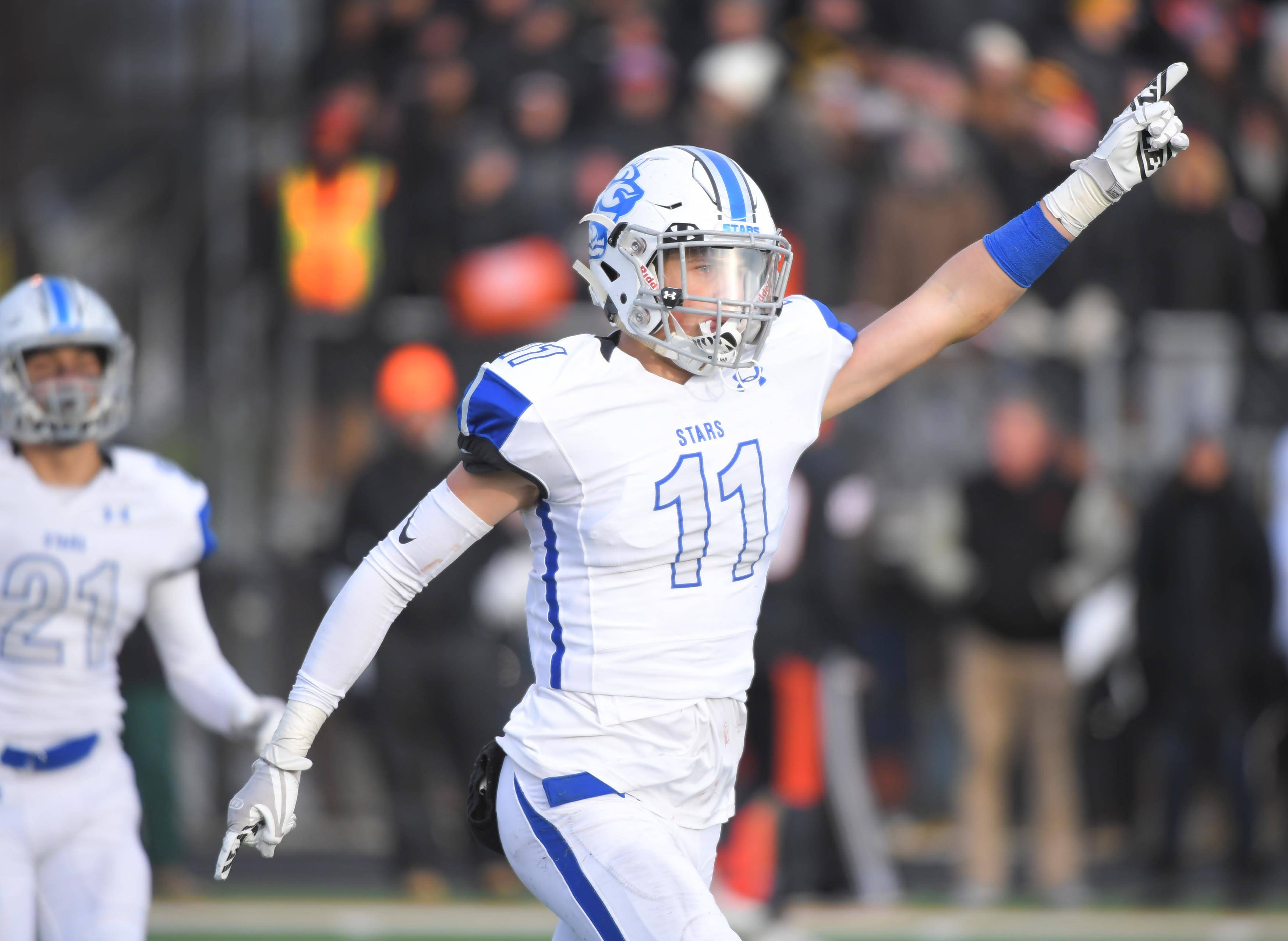 St. Charles North's Egon Hein reacts after intercepting a pass late in the game to preserve a win against Wheaton Warrenville South Saturday in a quarterfinal playoff football game in Wheaton.