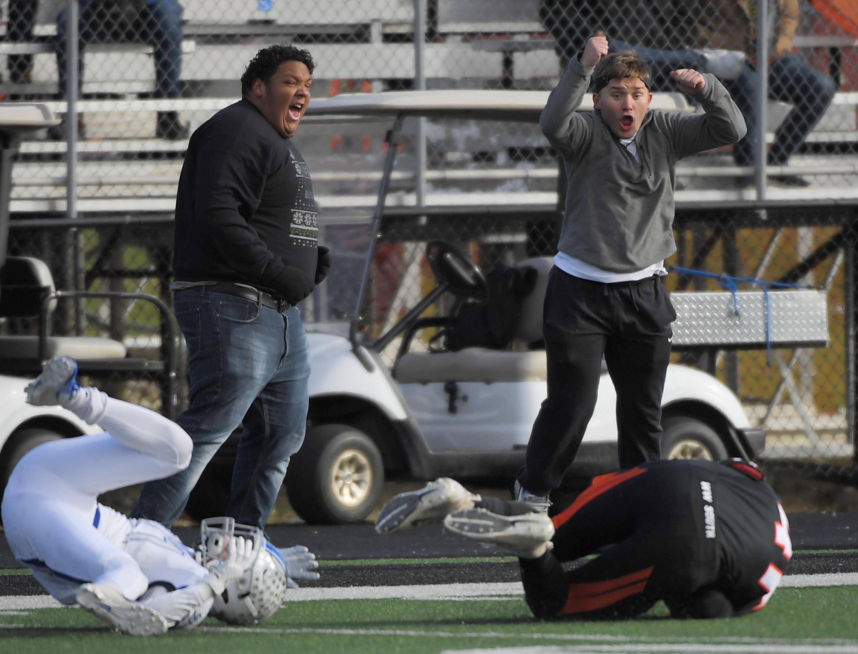 Fans reacts at Wheaton Warrenville South's Tyler Fawcett comes down with a first-down catch in the second quarter against St. Charles North Saturday in a quarterfinal playoff football game in Wheaton.