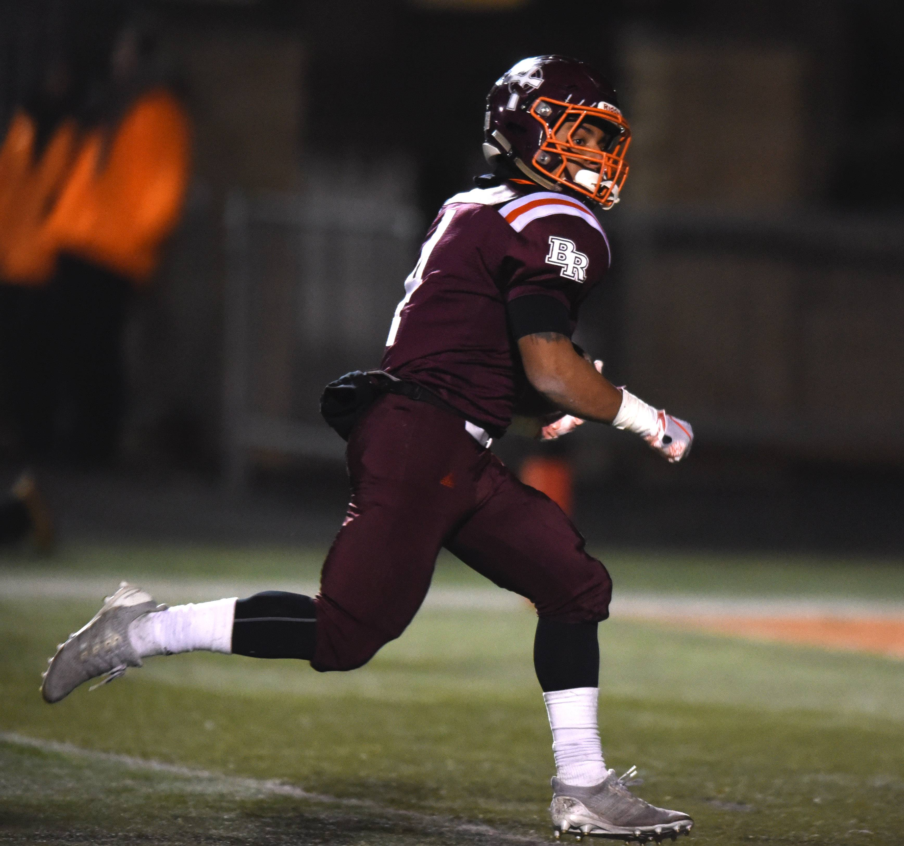 Brother Rice's Jesse Plunkett carries the ball for a touchdown during the Class 8A state quarterfinal against Warren in Chicago Saturday.