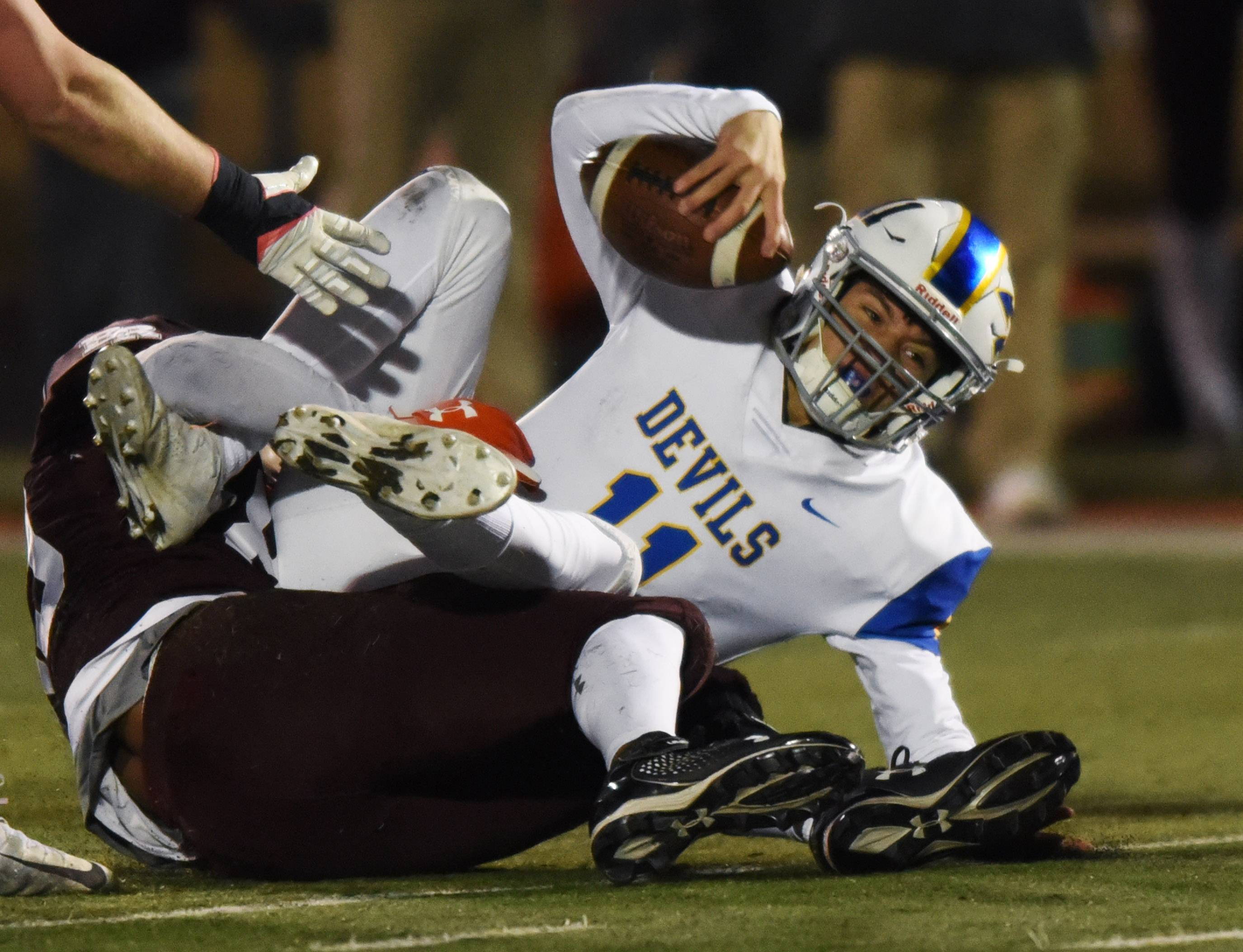 Warren's Phil Hird gets tackled during the Class 8A state quarterfinal against Brother Rice in Chicago Saturday.