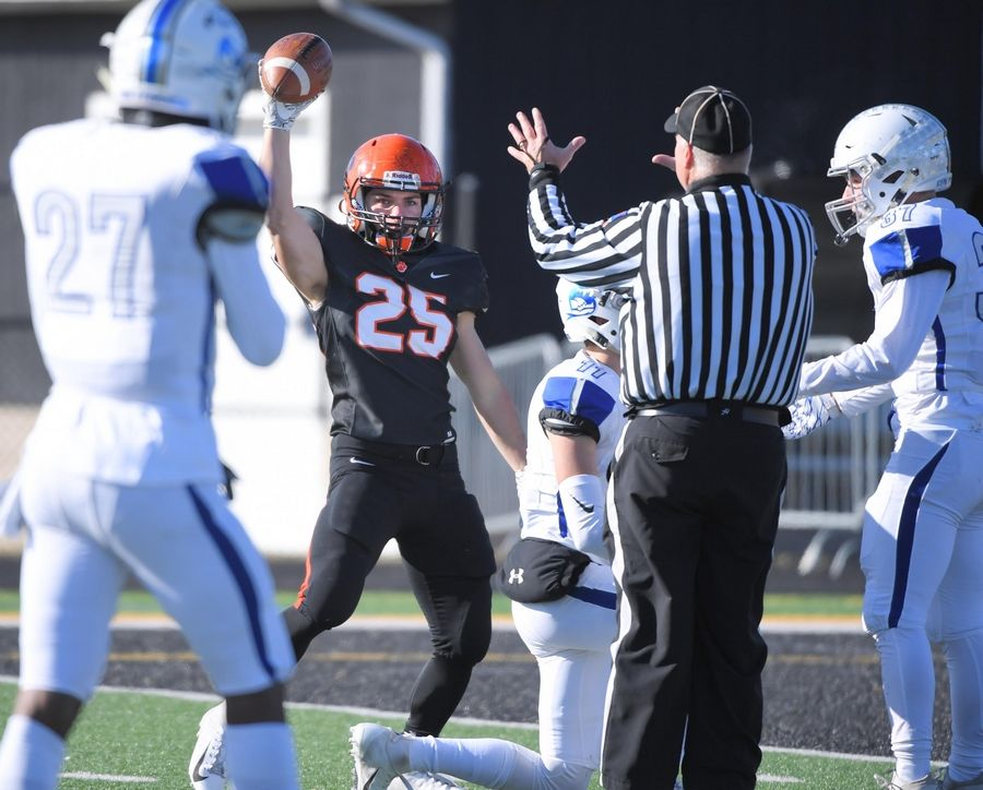 Wheaton Warrenville South's Jake Arthurs reacts after his ling catch in the first quarter that led to a touchdown on the next play against St. Charles North Saturday in a quarterfinal playoff football game in Wheaton.