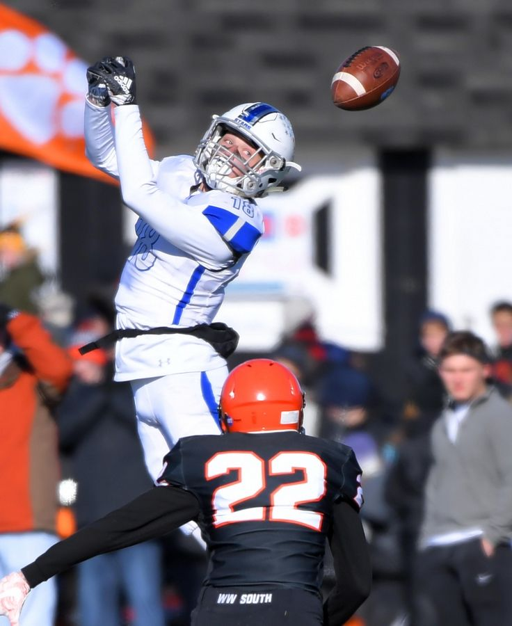 St. Charles North's Alec Kritta can't make a catch as Wheaton Warrenville South's Zach Powell closes in Saturday in a quarterfinal playoff football game in Wheaton.