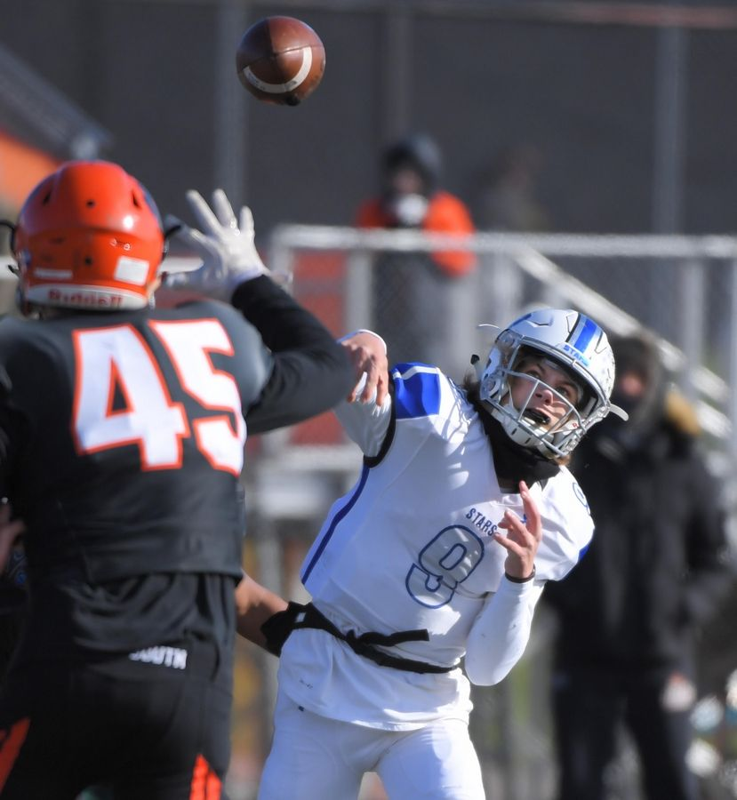 St. Charles North quarterback Peyton Brown throws against Wheaton Warrenville South Saturday in a quarterfinal playoff football game in Wheaton.