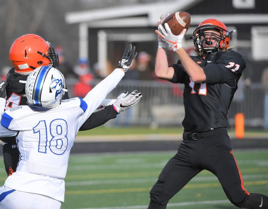 Wheaton Warrenville South's Joe Ives intercepts a pass intended for St. Charles North's Alec Kritta in the second quarter Saturday in a quarterfinal playoff football game in Wheaton.