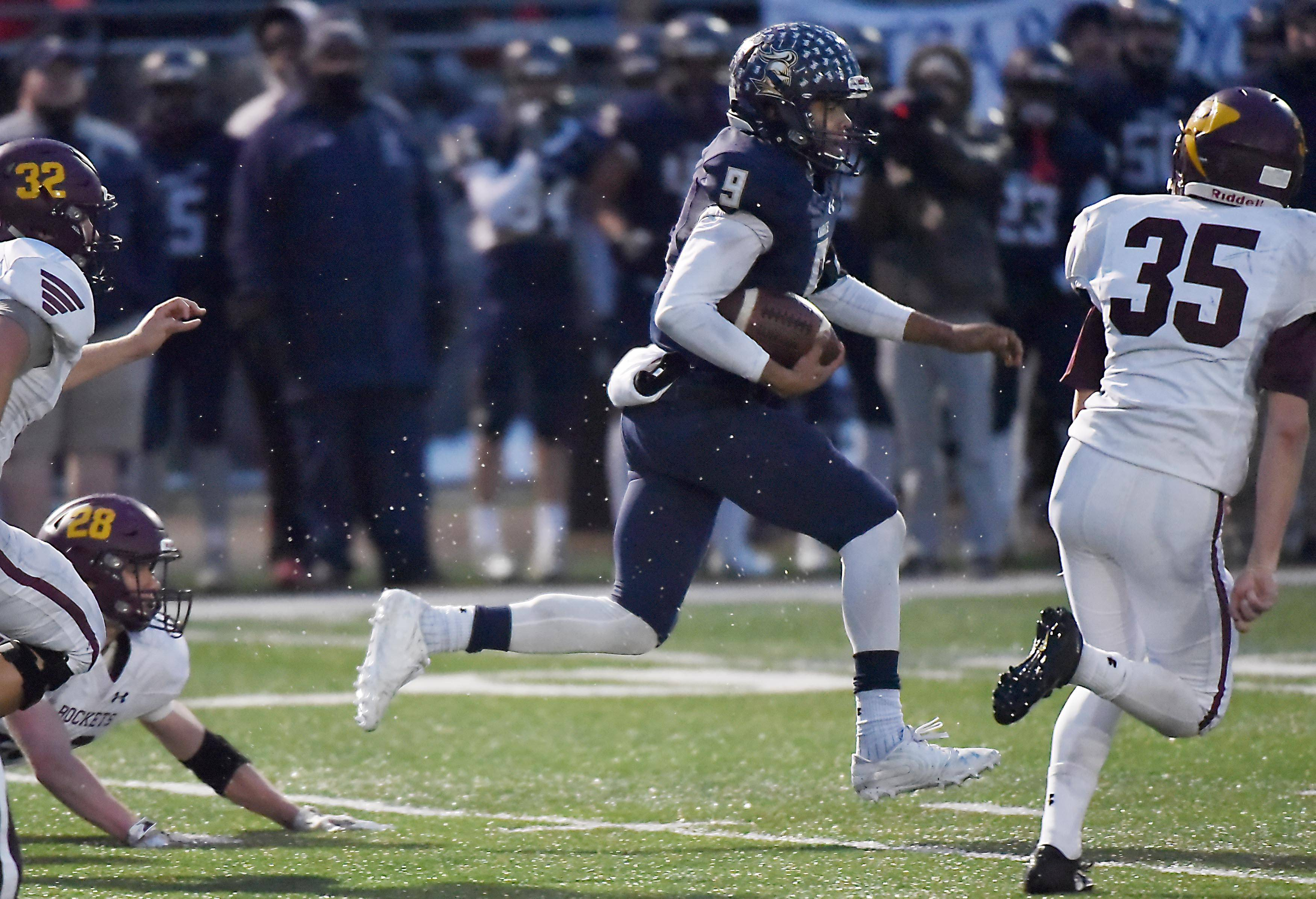 IC Catholic's Khalil Saunders runs for a long gain in the first half against Richmond-Burton in a semifinal football playoff game Saturday in Elmhurst.