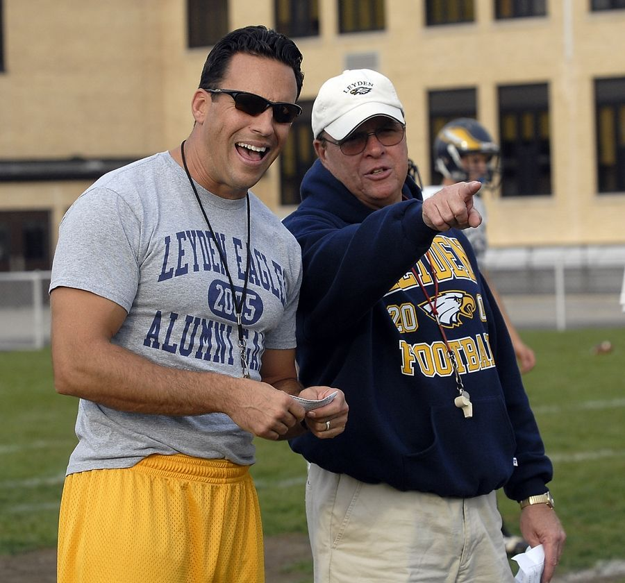 Leyden High School football coach Tom Cerasani Jr., left, and his dad, Tom, are shown here coaching a Leyden practice in 2008. Tom Cerasani Sr. passed away Sunday at 71.