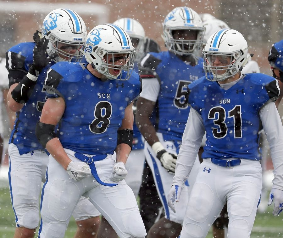 Ben Furtney (8) celebrates during St. Charles North's win over Mt. Carmel.  The North Stars will play Nazareth for the state championship Saturday.