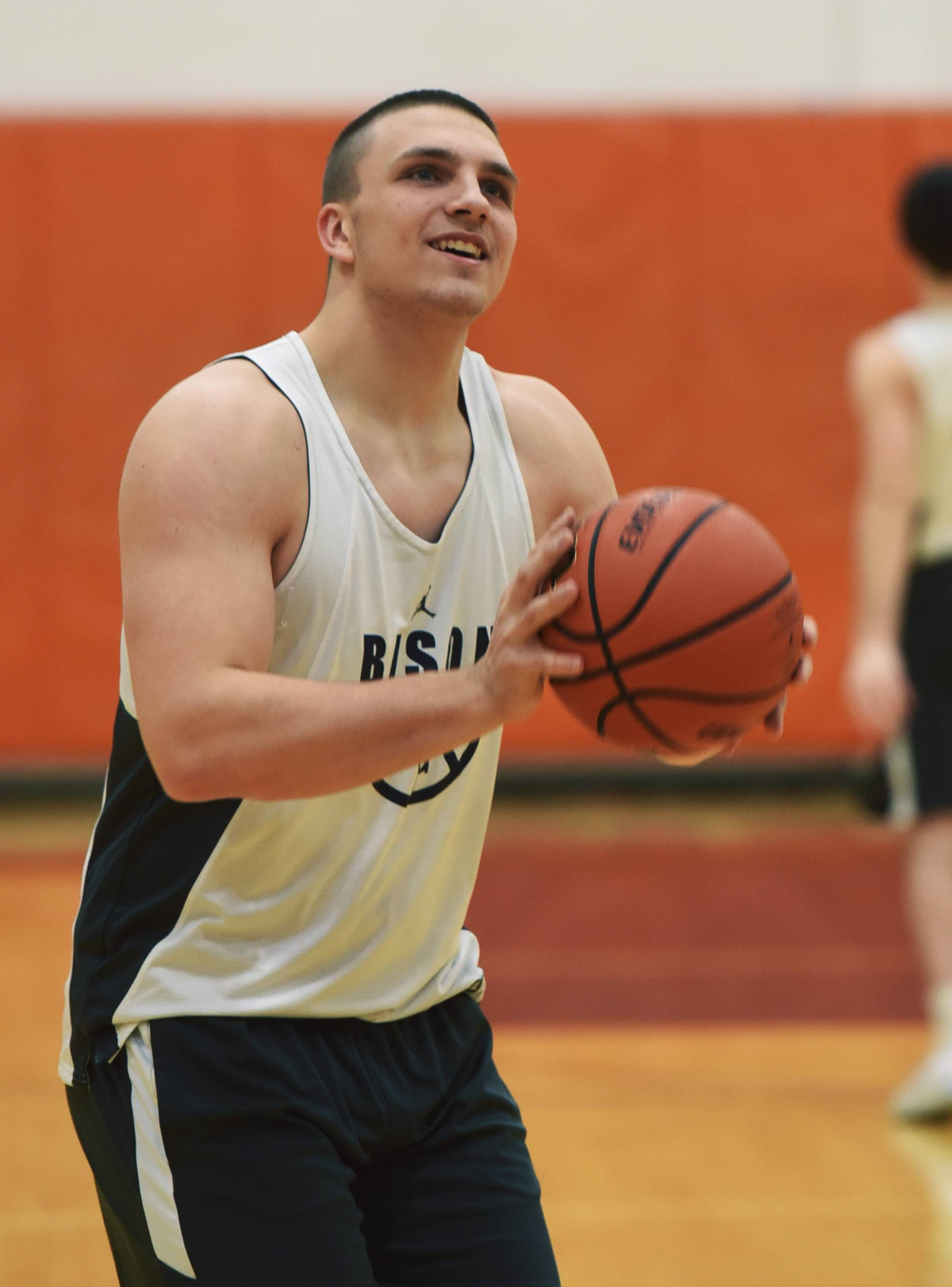 Buffalo Grove boys basketball player Tom Trieb shoots during practice.